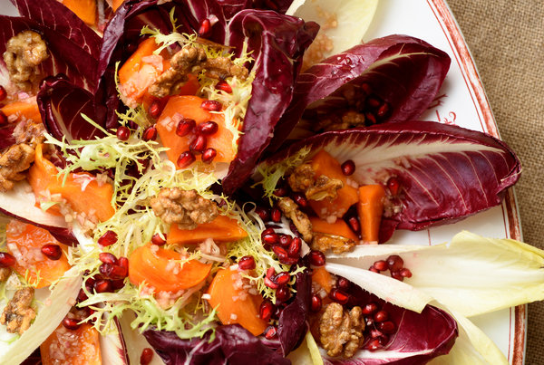 Persimmon and Pomegranate Salad with Candied Walnuts - Seasonal persimmons and pomegranates make an eye catching combination. This salad is festive and brightens a heavy holiday meal.