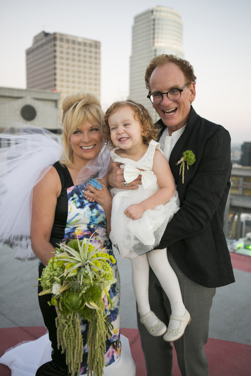Monica and Joe on the rooftop of 1010 Wilshire on their wedding day, catered by Urban Radish