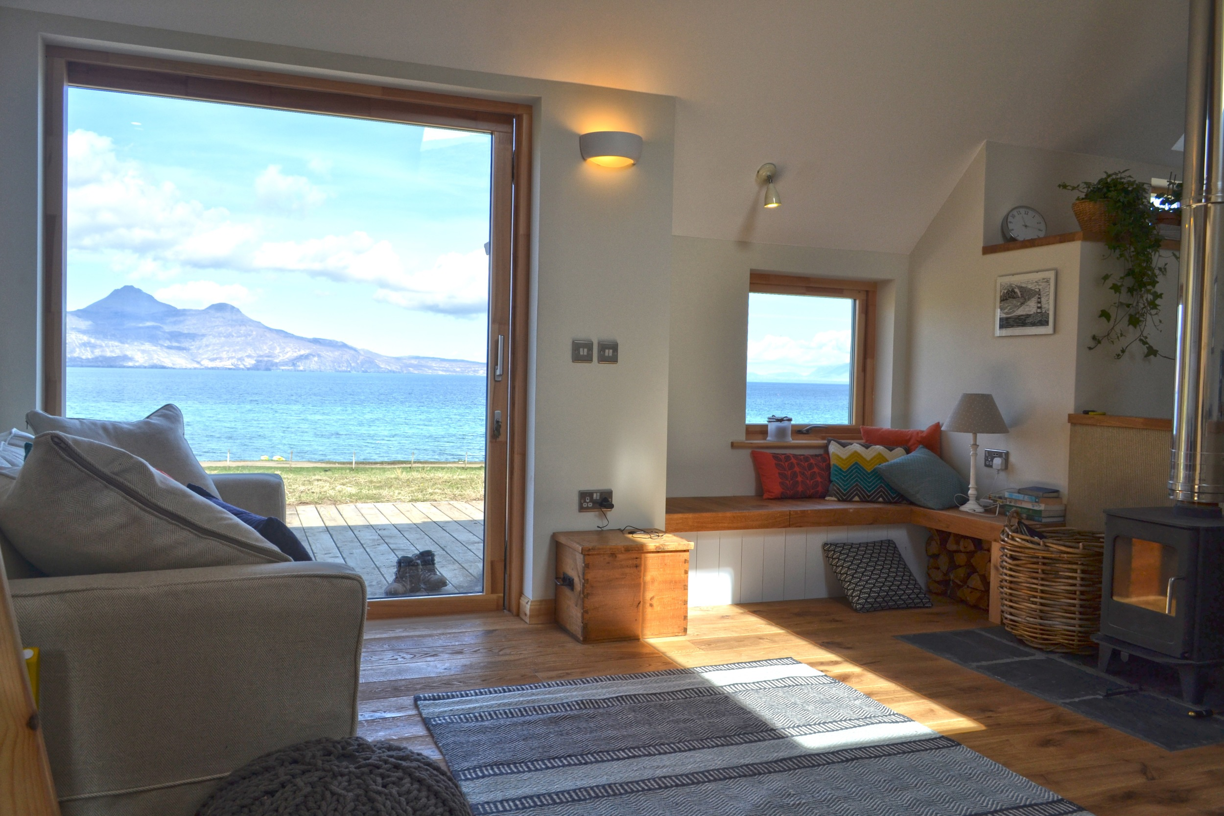 Living room with views from sliding door out to Isle of Rum