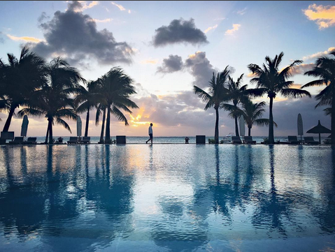 """Beachcomber Paradis Hotel & Golf Club. """"After a wonderful tour of the south and a surprising discovery of Le Morne and it's magnificent mountain. We got just in time for a swim in the swimming pool of Beachcomber Paradis, with a beautiful sunset as company."""""""
