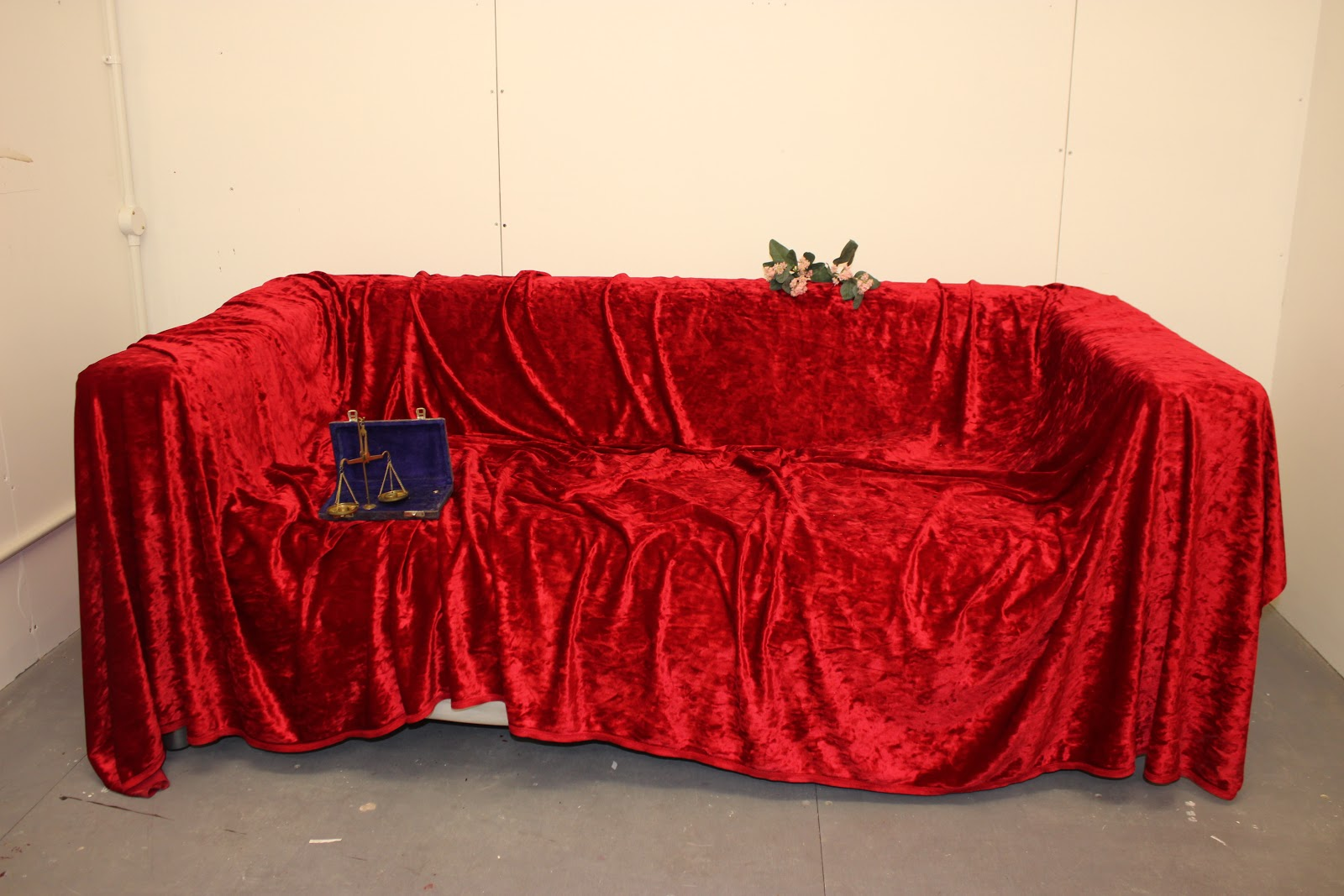 The red sofa where J takes her naked photos