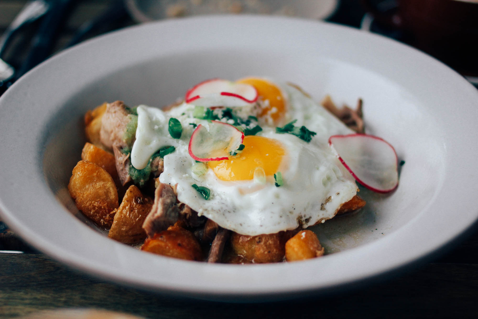 Smoked pork with crispy potatoes, fried eggs