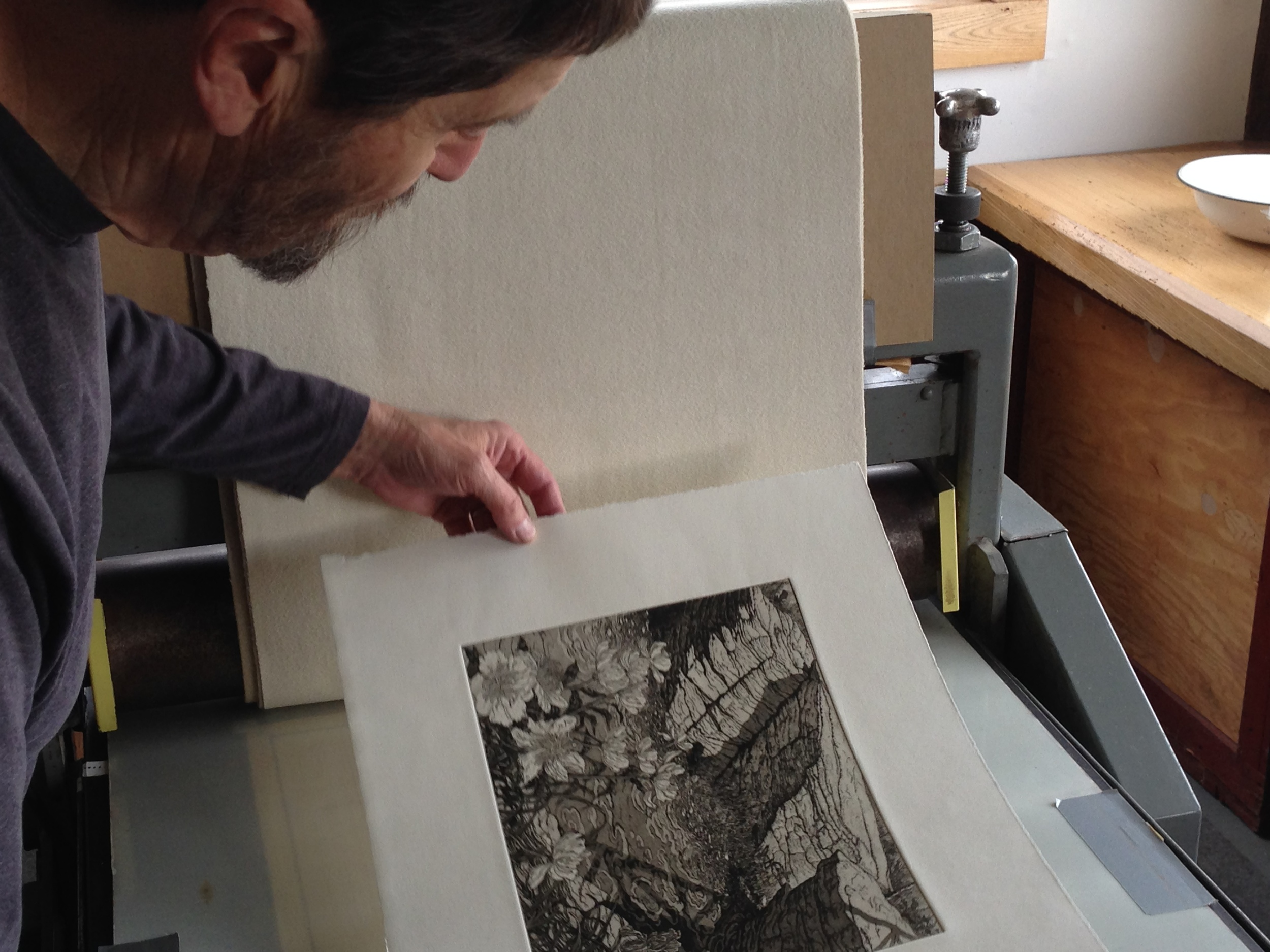 Roger Bailey examines one of the edition prints.