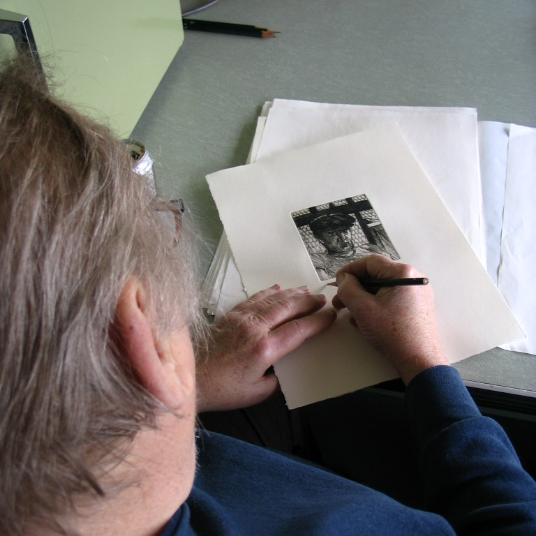 Jack Beal signs the edition of etchings, April 28, 2005.