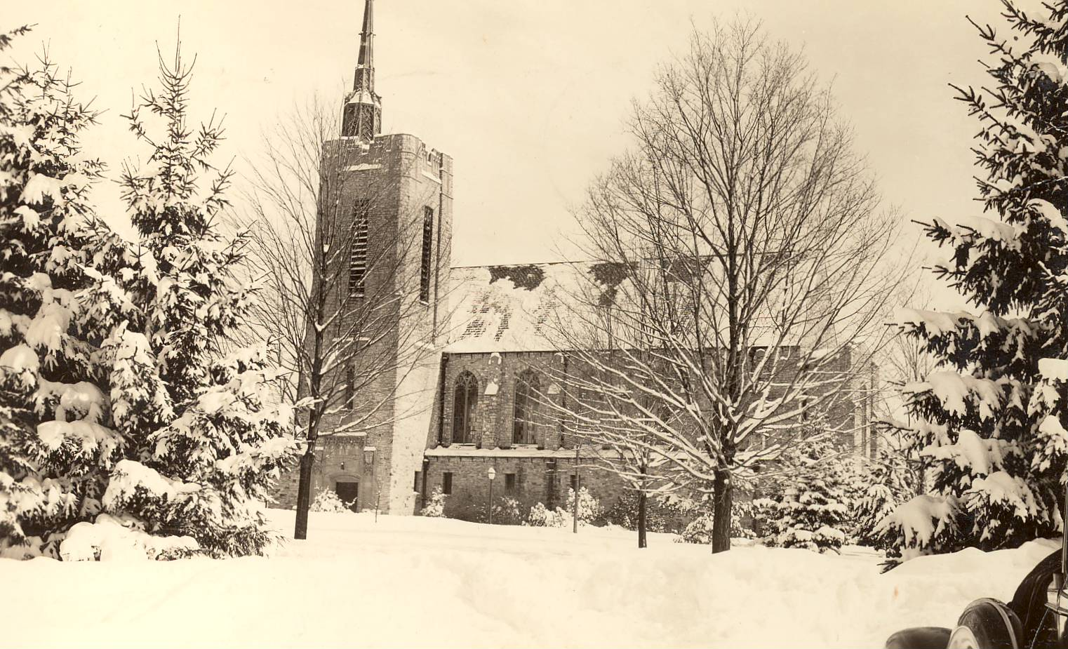 Gunnison Chapel on the campus of St. Lawrence University, in the snow. This image is from a postcard published in the 1940's.