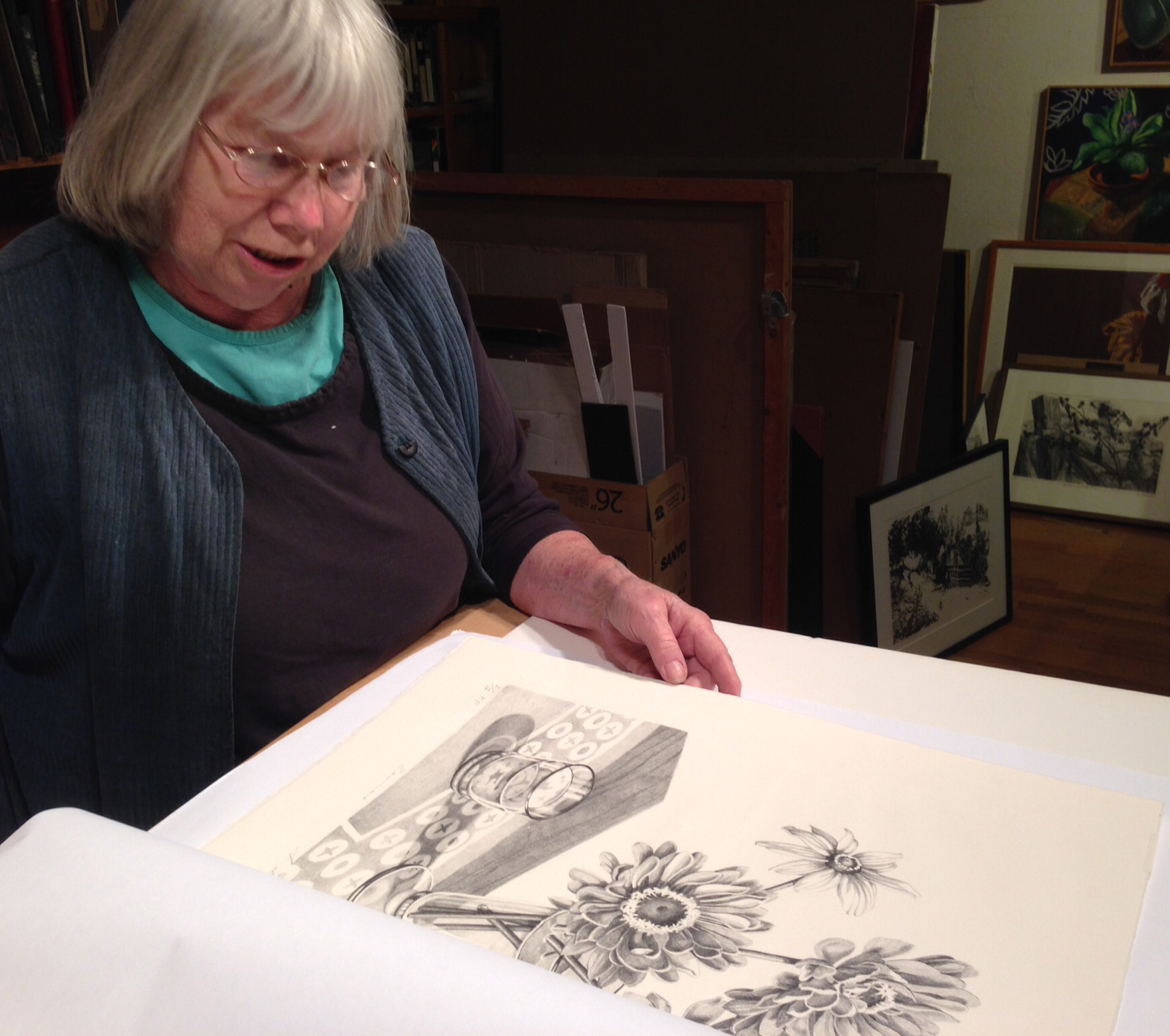 Sondra examines one of the prints from the edition.