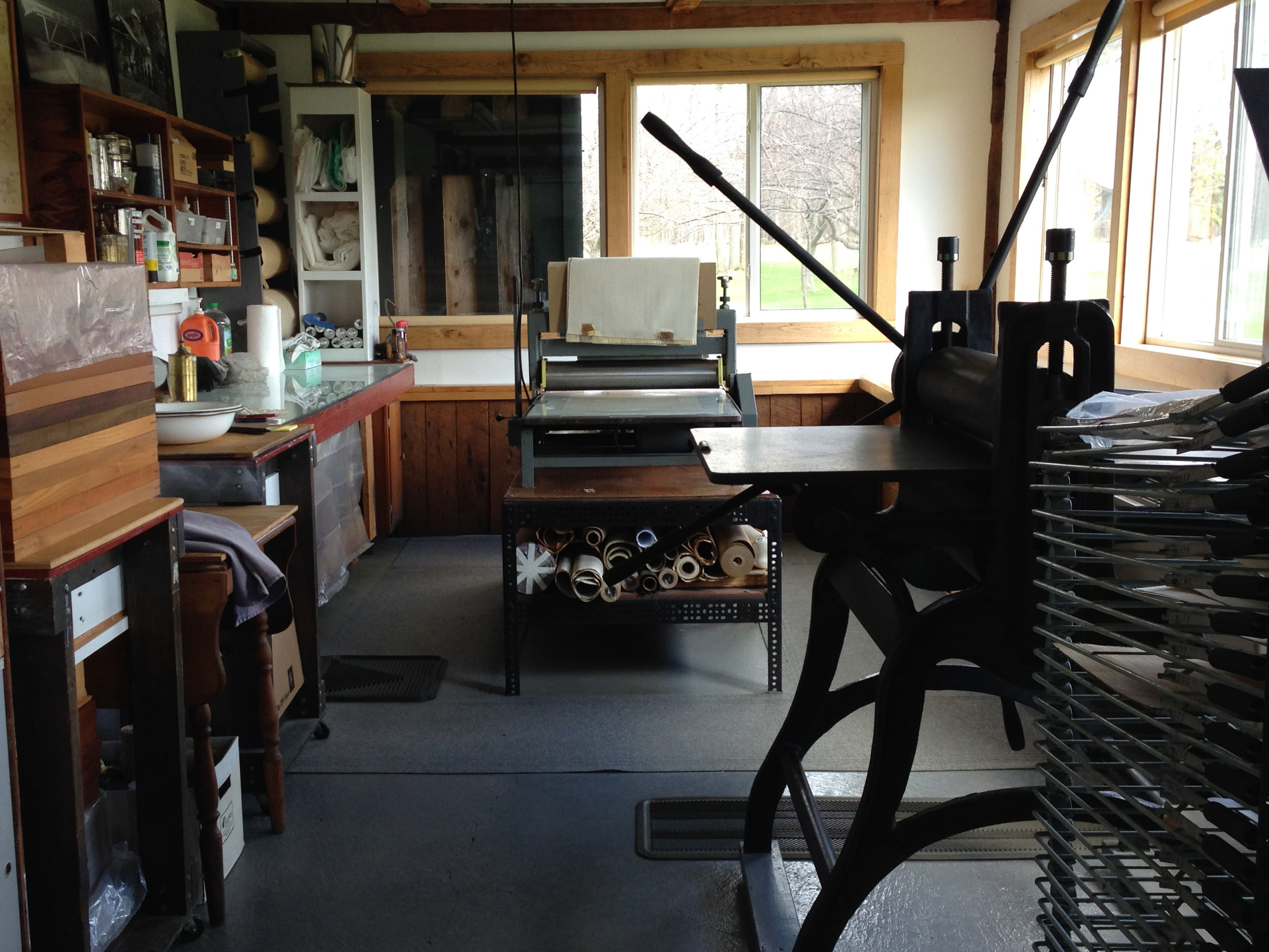 The print studio. A Rembrandt etching press on the right, and a motorized Dickerson combination lithography and etching press in the back. Modest equipment but it does the job.