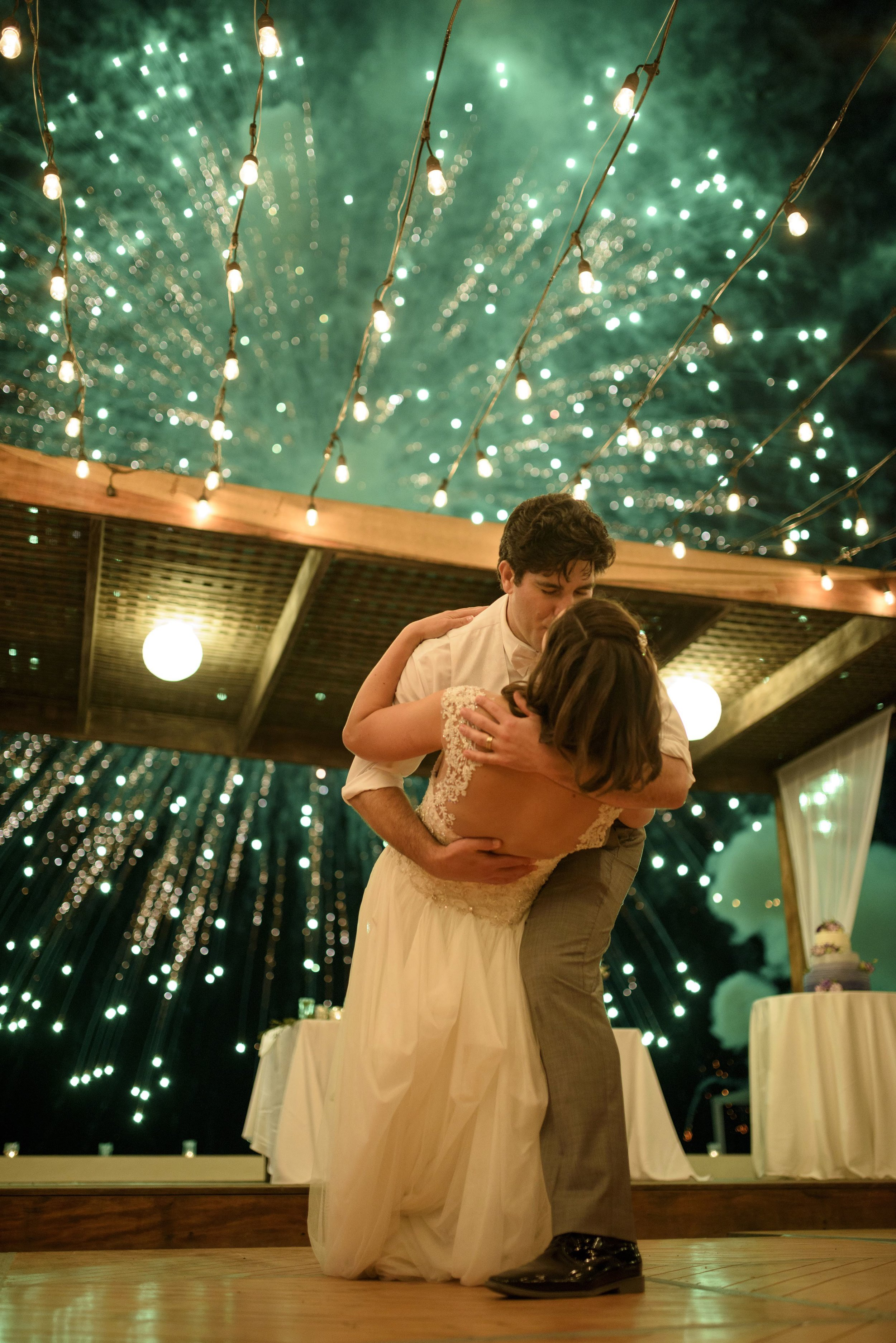 Bride and Groom Kiss Underneath the Fireworks at Mexico Destination Wedding
