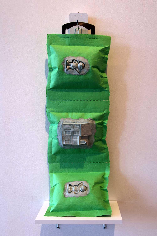 "Hitotsuzutsu (One per Person): Bob the Builder    2013, Paper casting: abaca fiber, dye, wood, 28""x11""x9"""