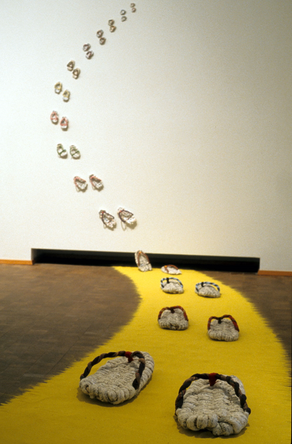 "2004, 80""x65""x140""  Installation: wish paper, fabric, ropes, sand"