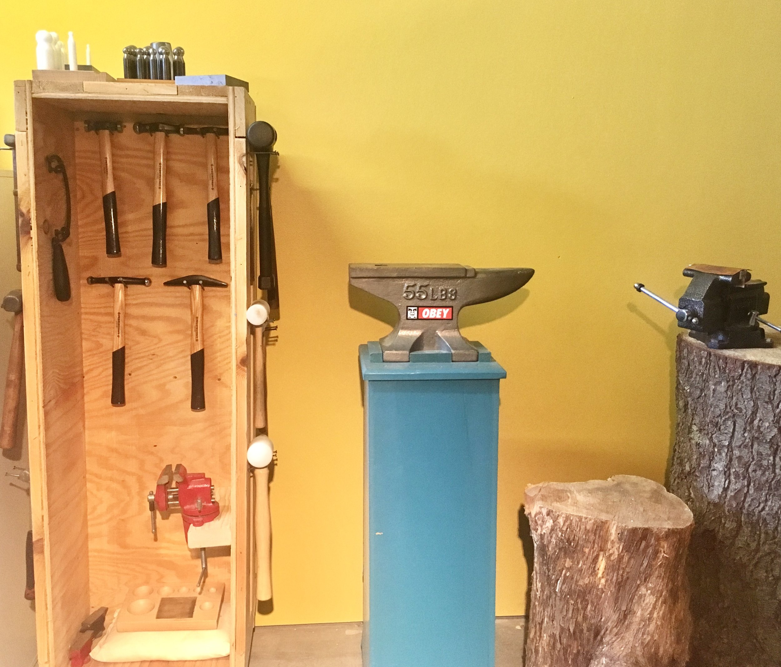 My hammer and tool cabinet is complete and nestled in nicely with my anvil and stumps.