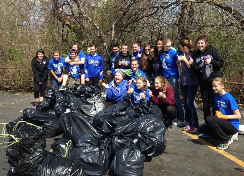 Riverside-Brookfield High School students proudly display trash collected at one Addison Creek site.