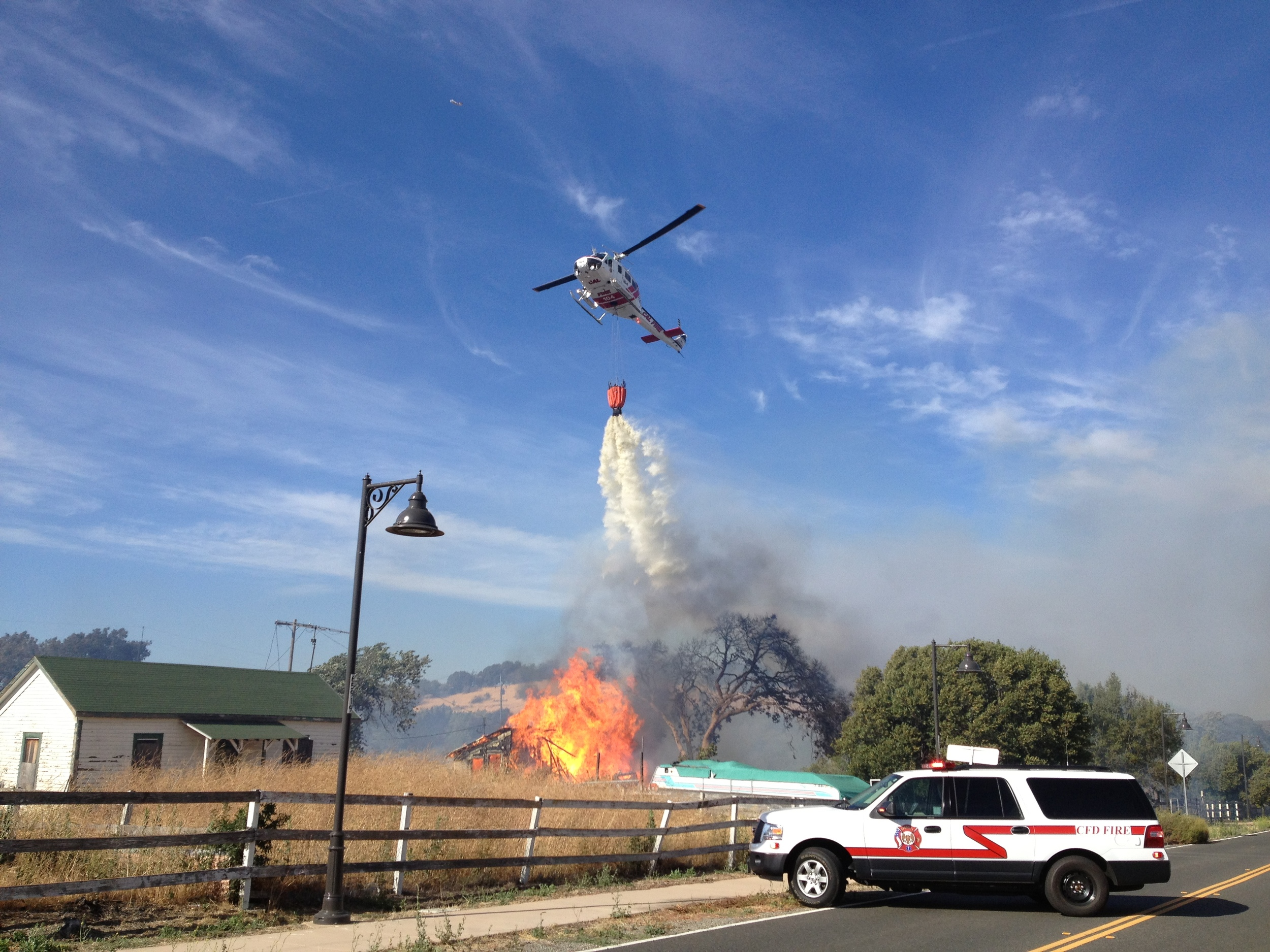 iPhone photo of CalFire helicopter water drop. By the way, it's up to the reporter to get out of the way or be doused.