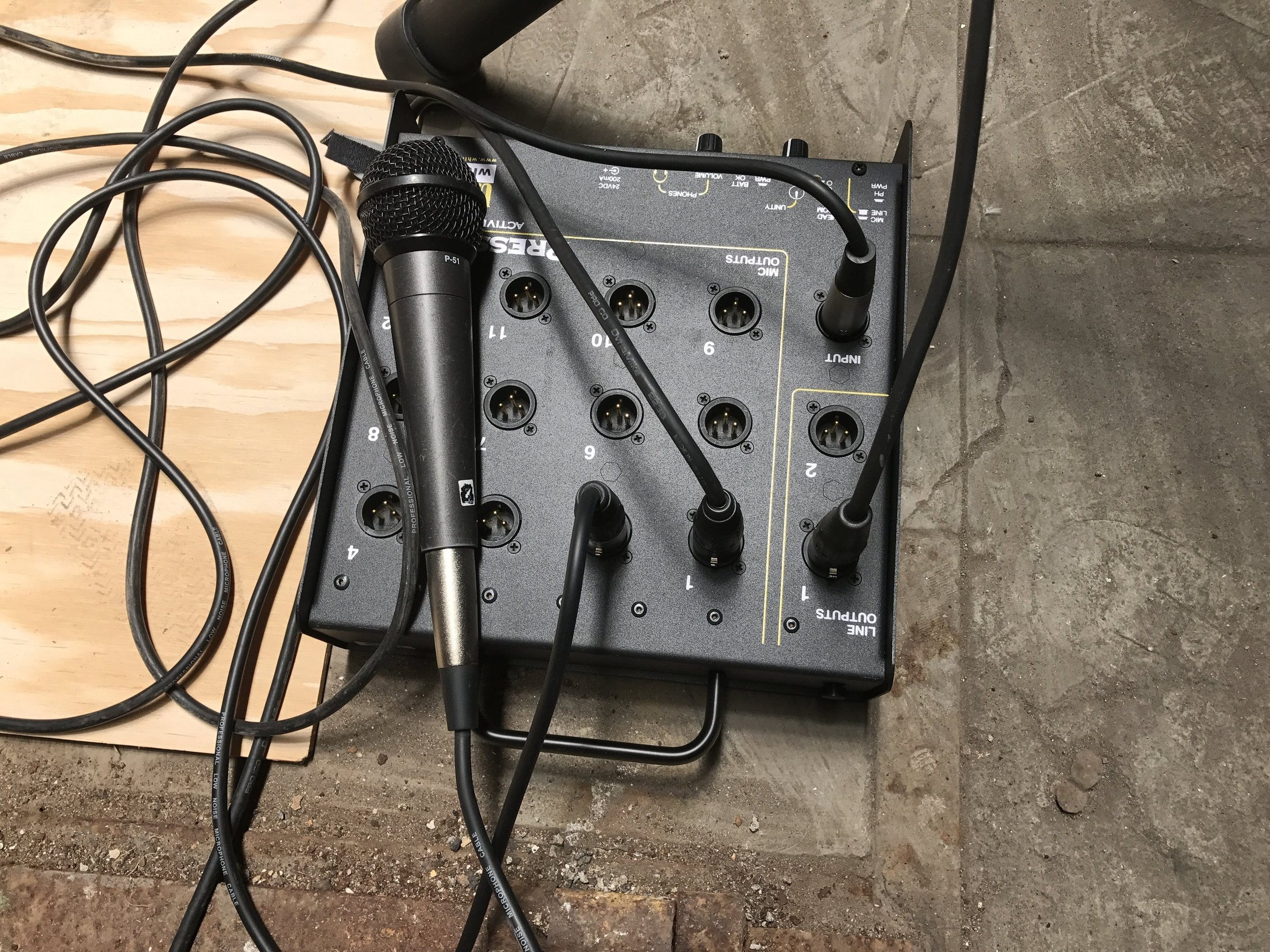 This is a mult box. The microphone cable sends the audio signal into the box and that signal is sent out through all the various outlets so several news teams can record at once.