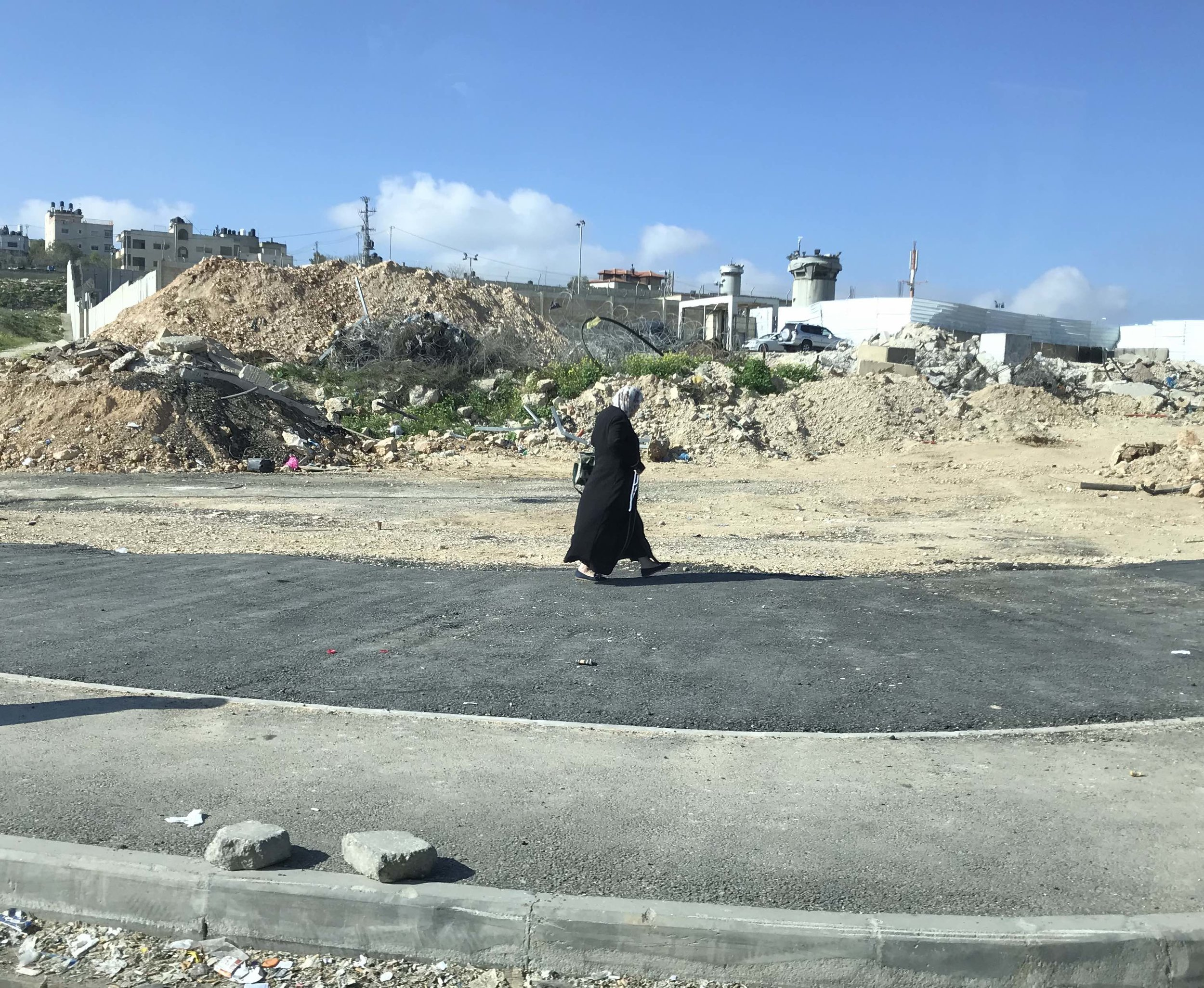 Woman walking near the checkpoint in East Jerusalem.