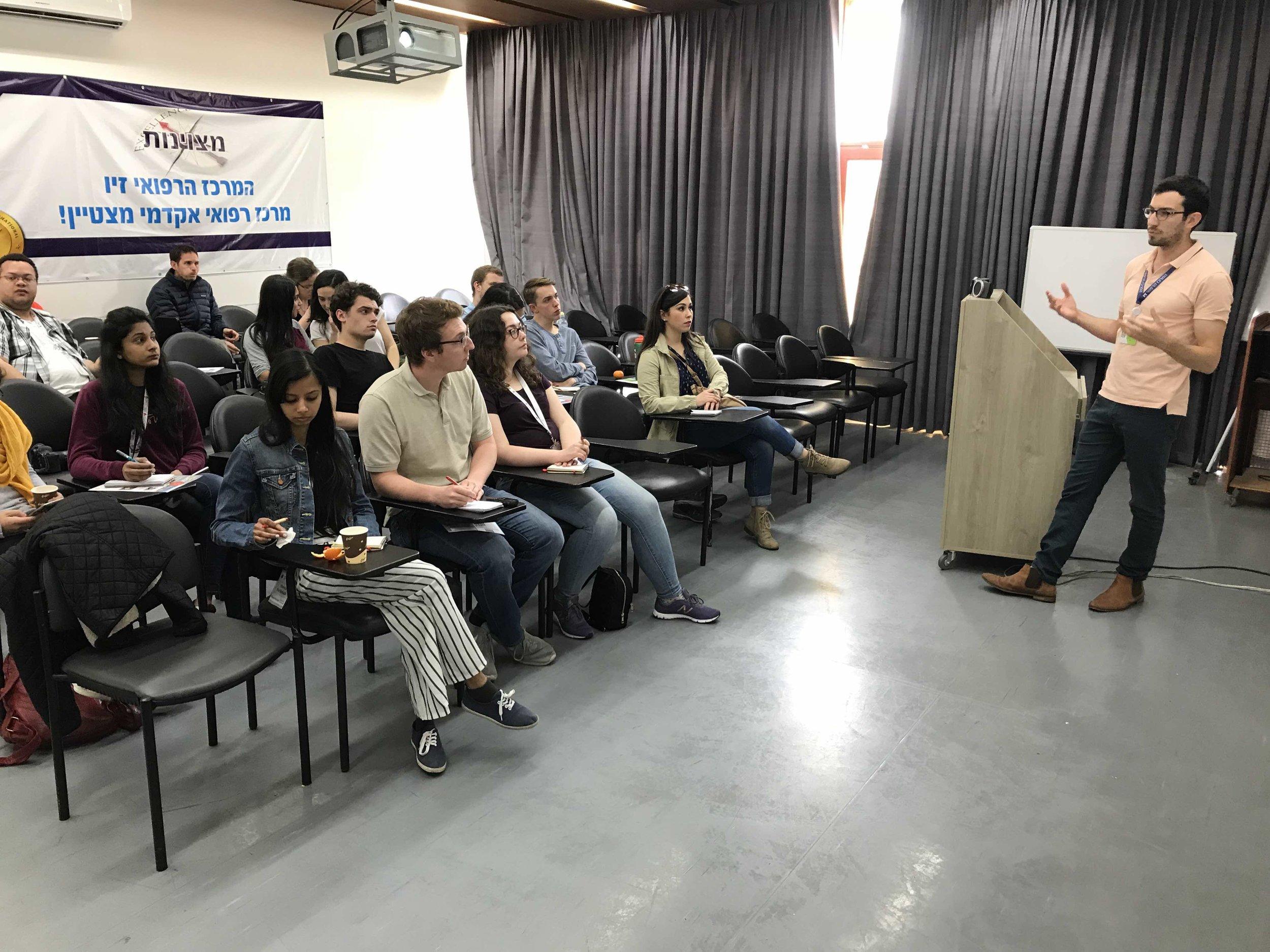 Newhouse students listen to Ziv Medical Center Spokesman Yarden Izak.