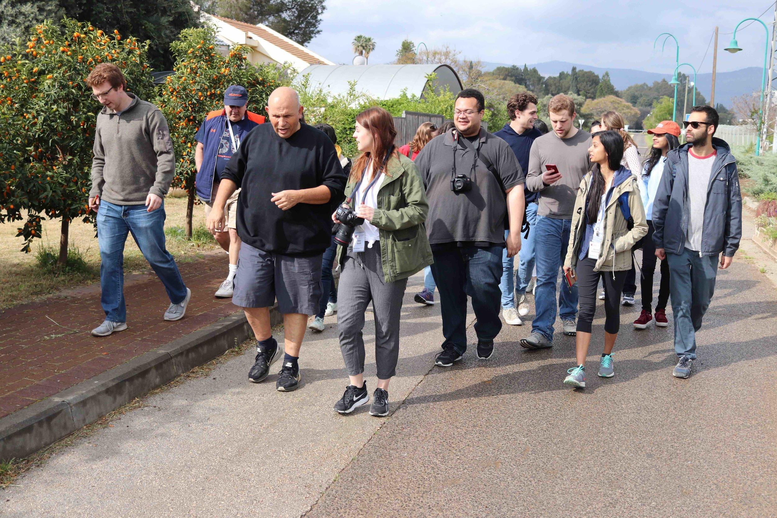 Barry Praag leading students on a tour of Kibbutz Dafna.