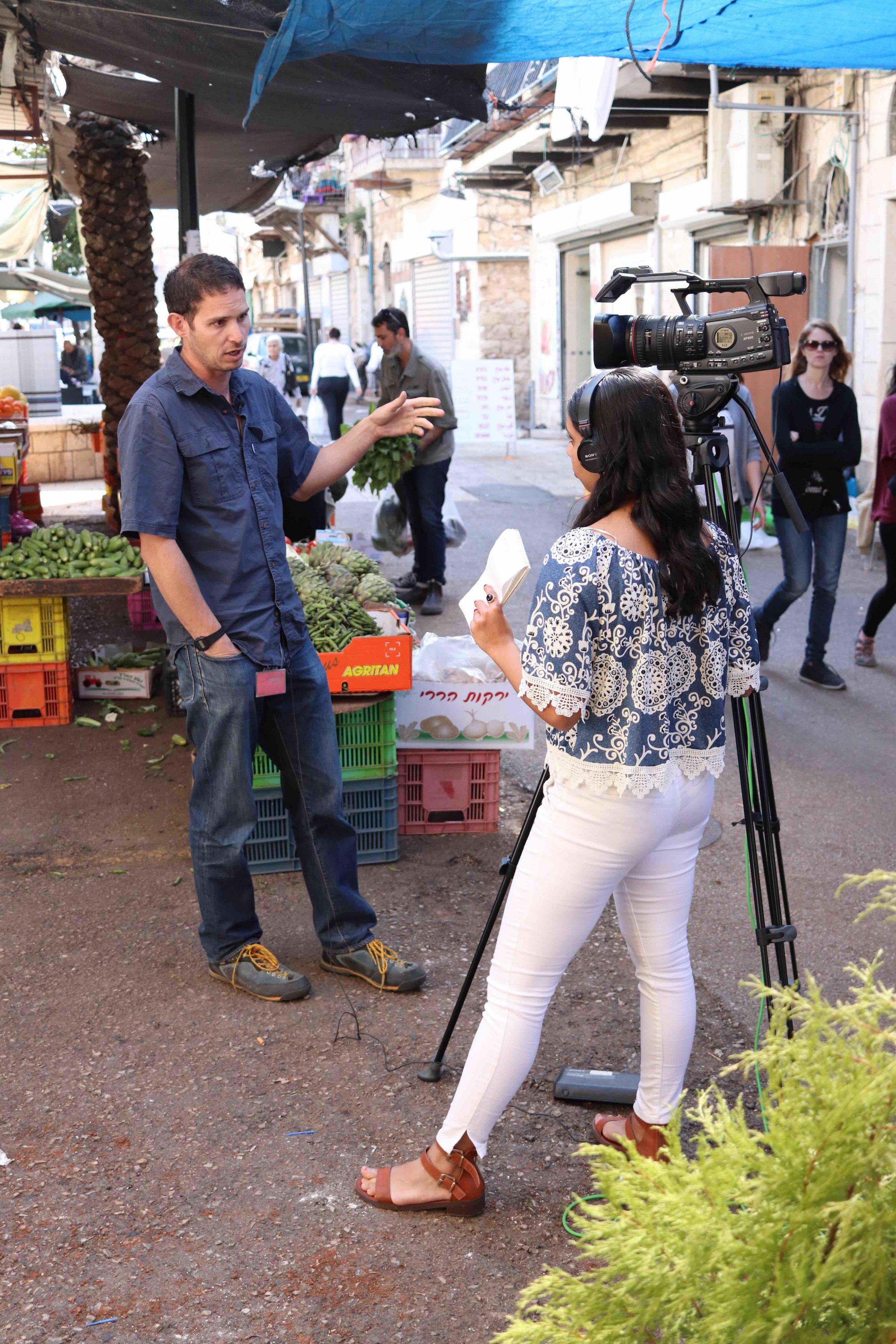 Newhouse broadcast student Rashika Jaipuriar conducts an interview in Haifa.