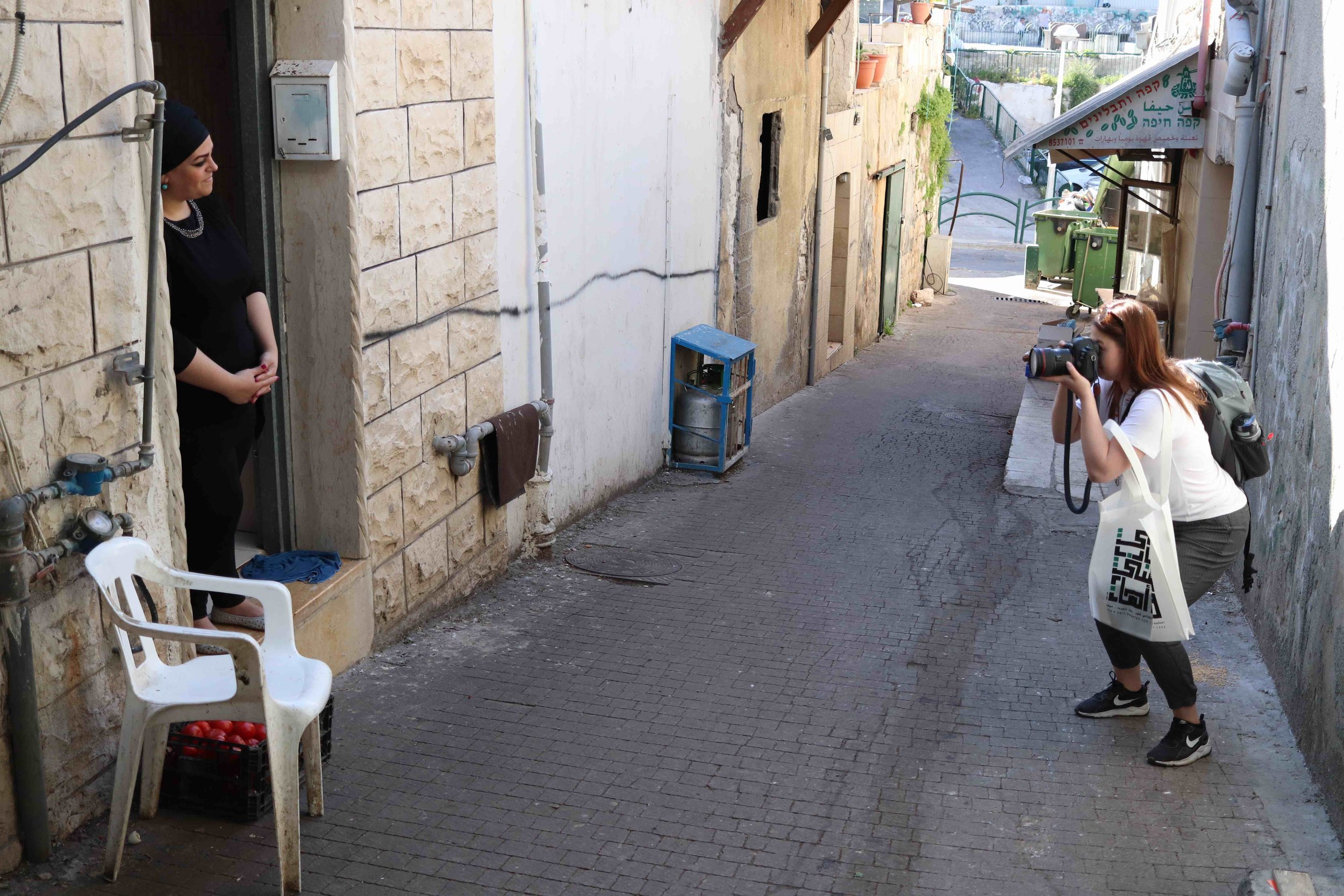 Newhouse newspaper and online journalism student Riley Bunch shoots a photo for her story on Israel.