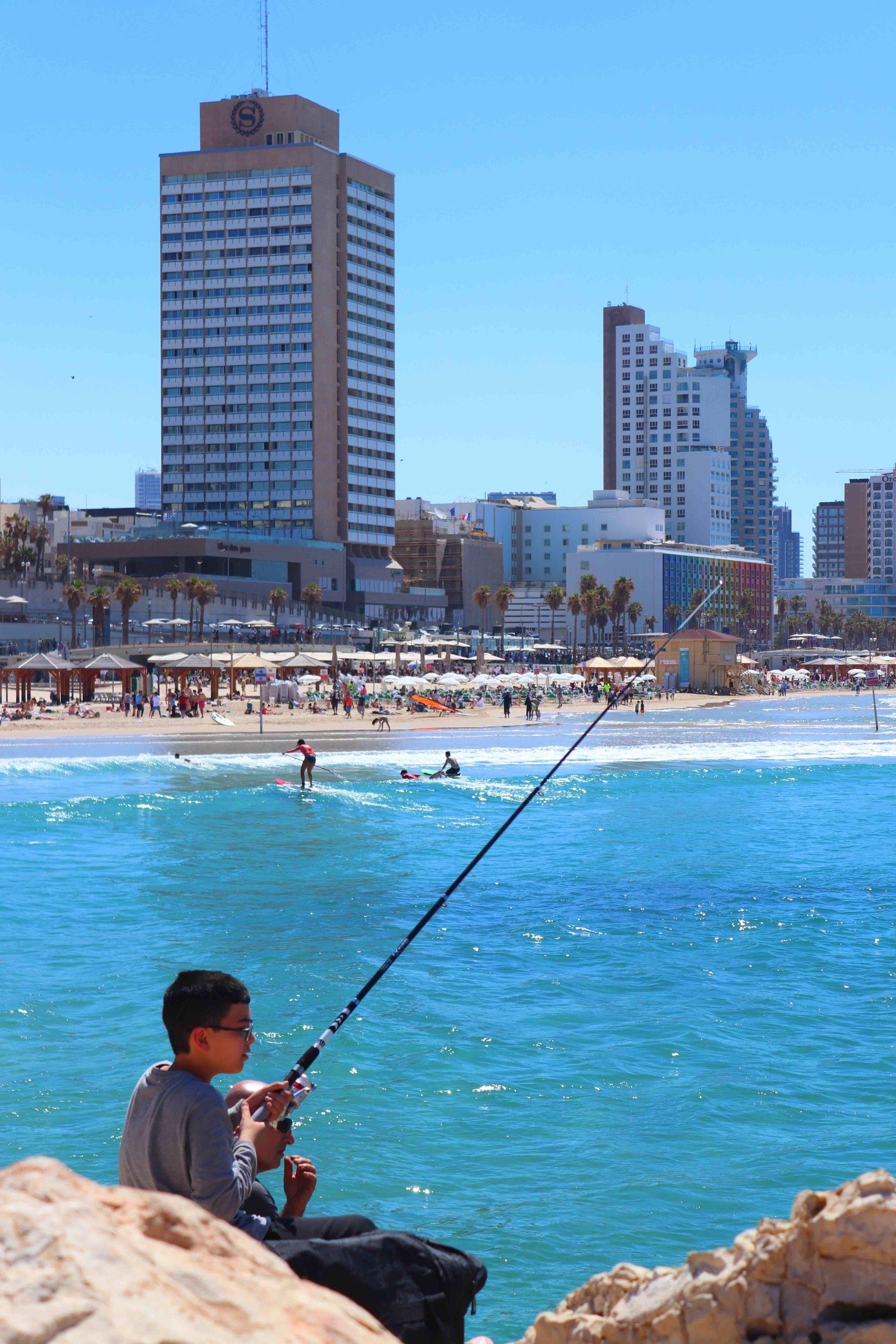 IMG_1765 lower quality boy fishing.jpg