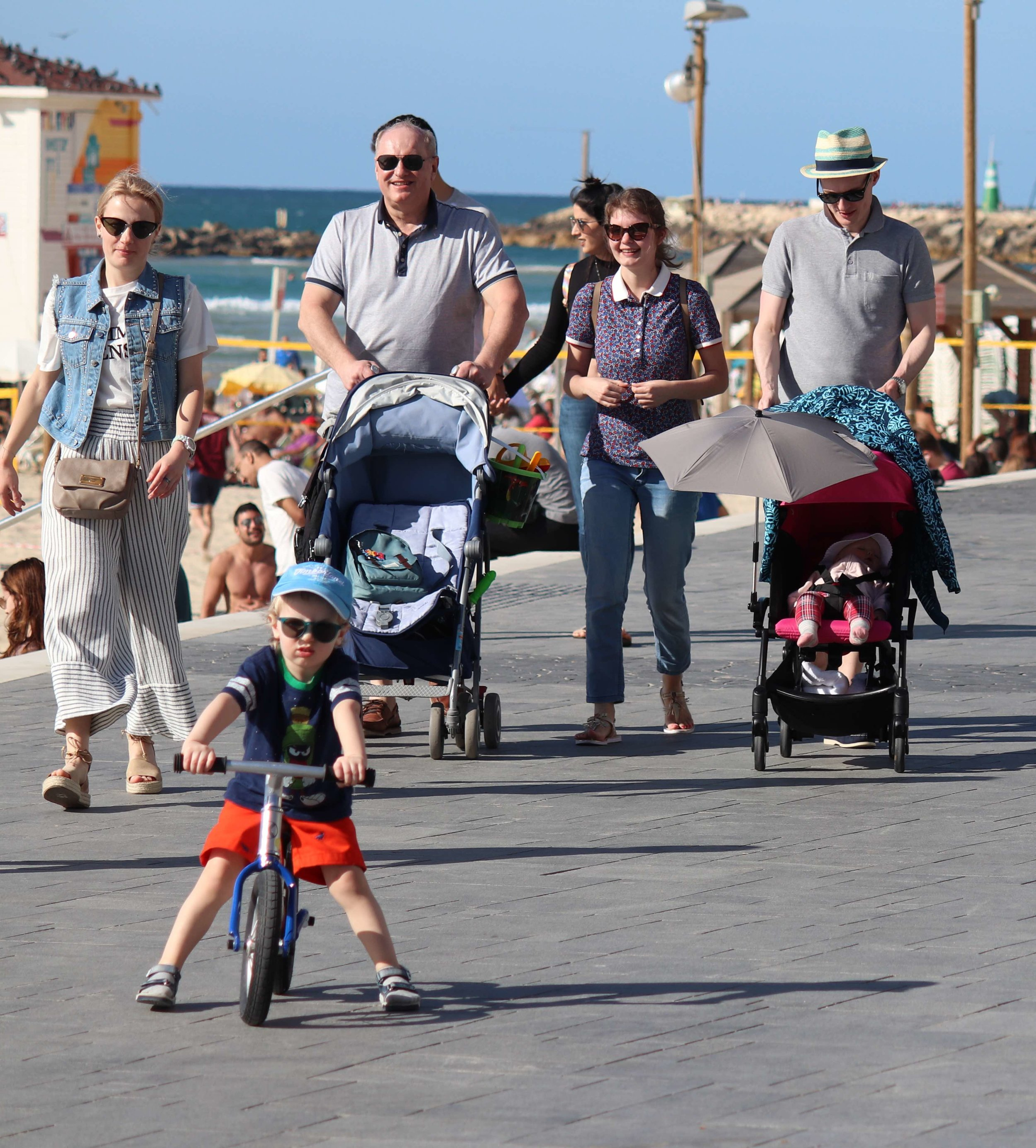 family with strollers and kid on bike lower quality.jpg