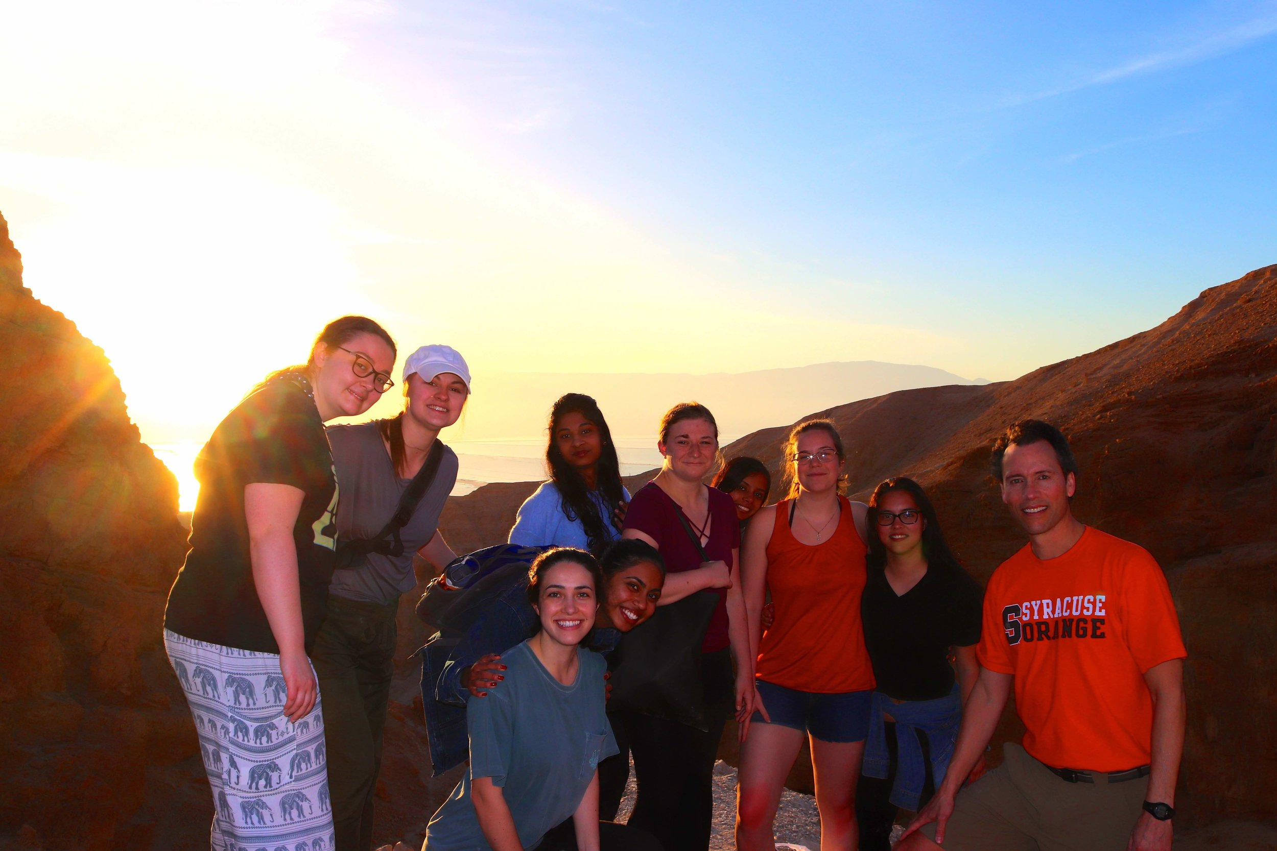 Newhouse students at sunrise overlooking the Dead Sea.