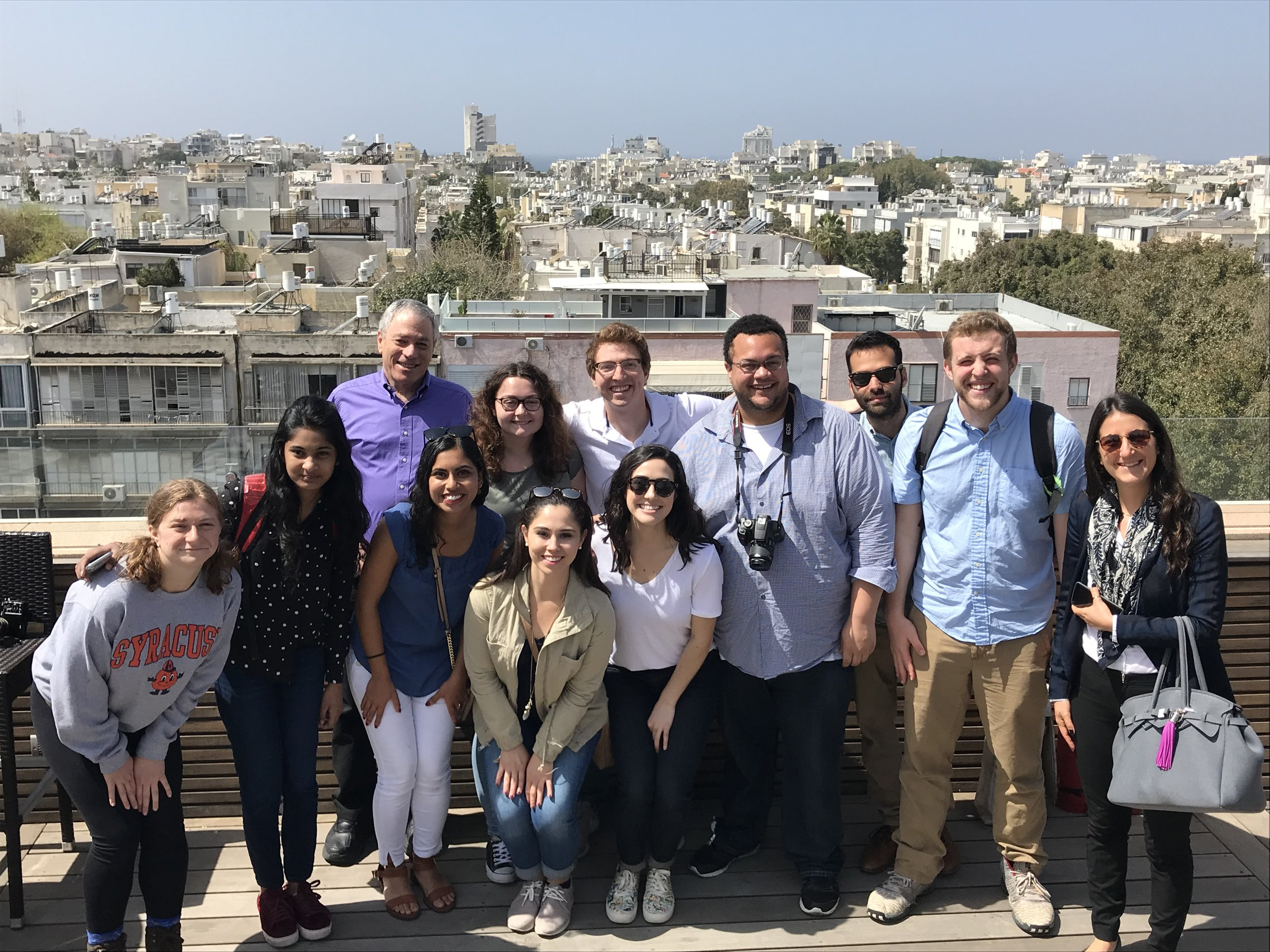 The #NewhouseinIsrael team overlooking Tel Aviv from the roof of Walla News Digital Network.