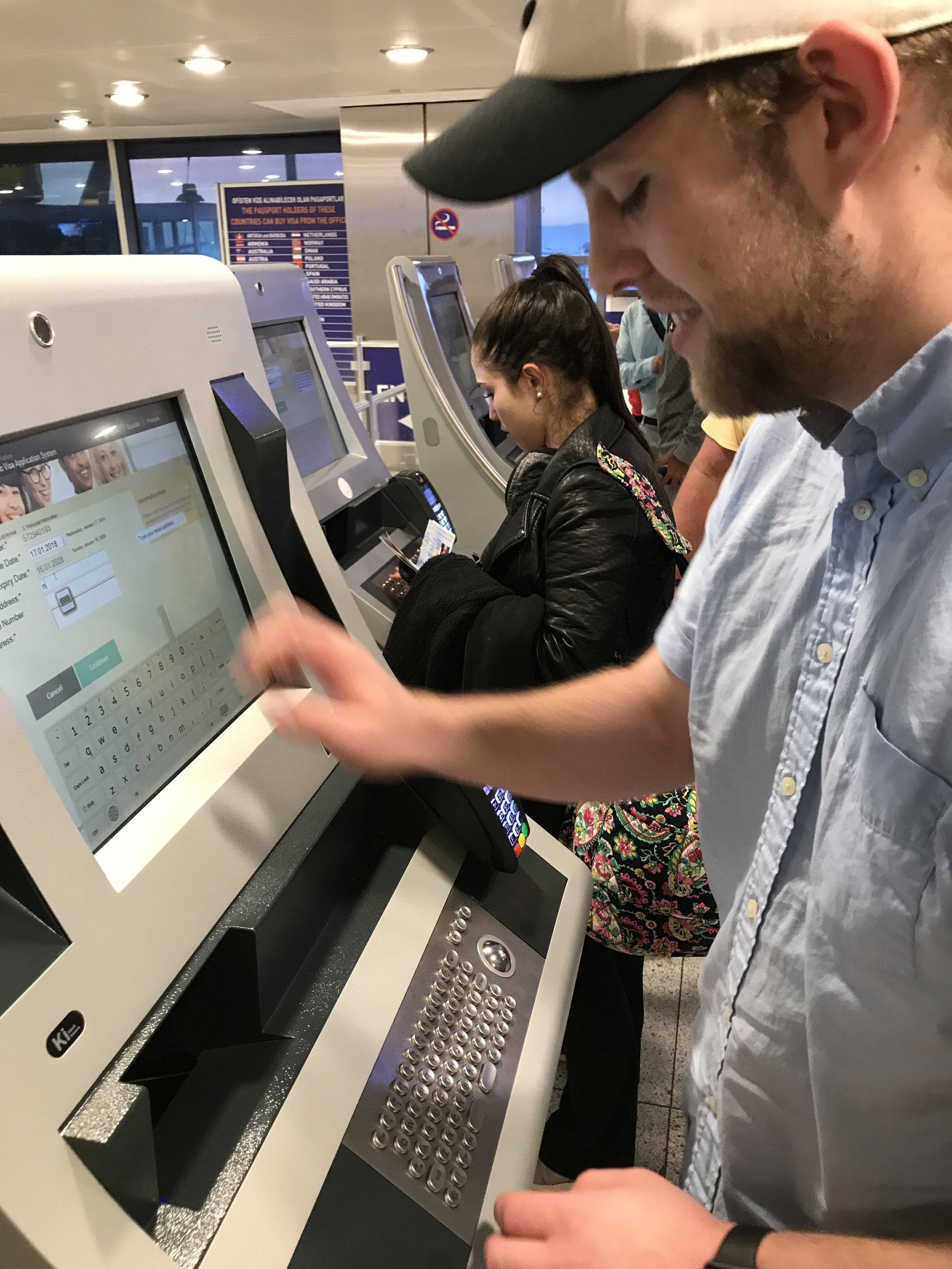 Airport kiosks in Istanbul dispense visas to Newhouse students so they can enter Turkey.