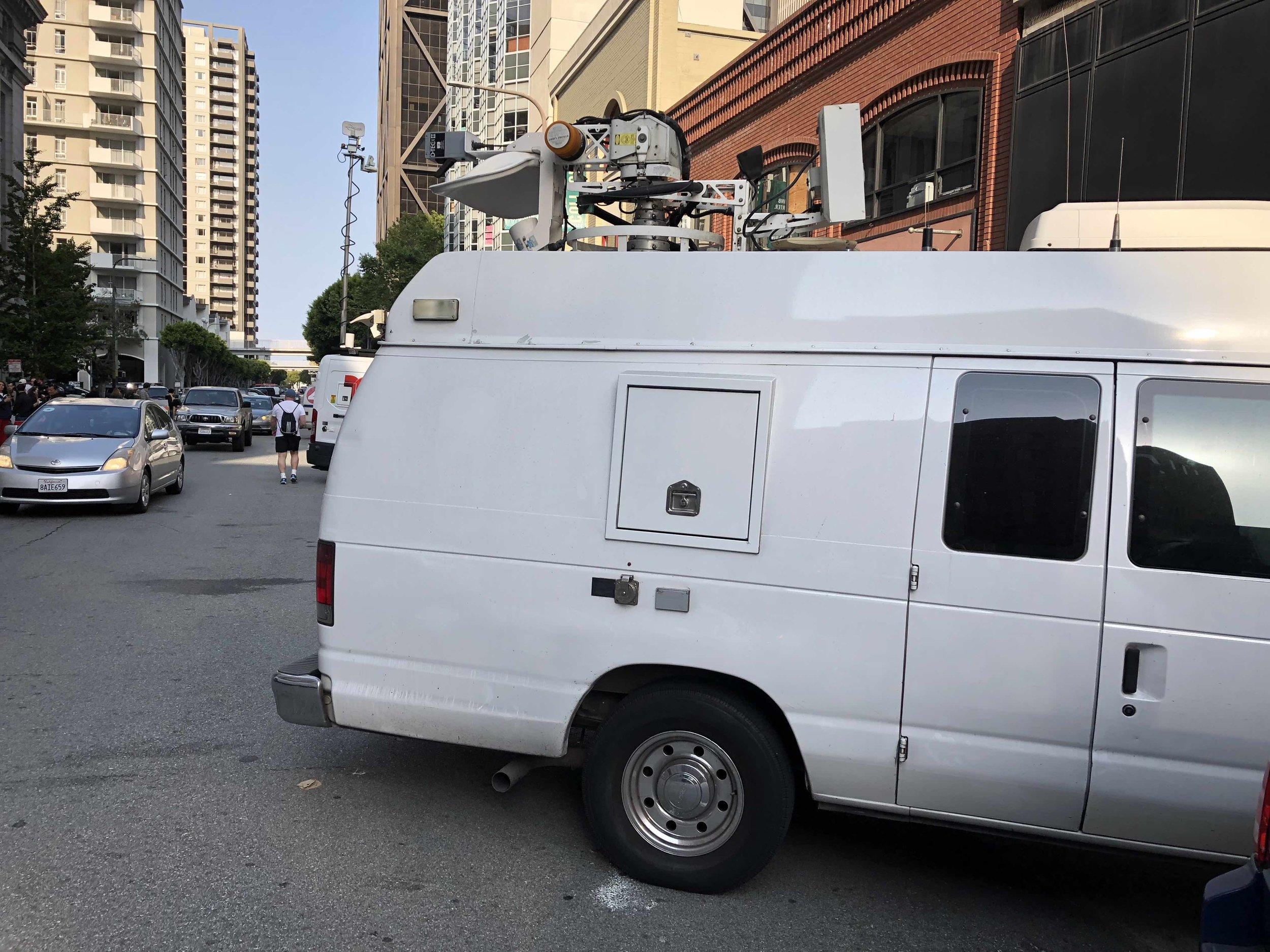 The traditional huge news van.