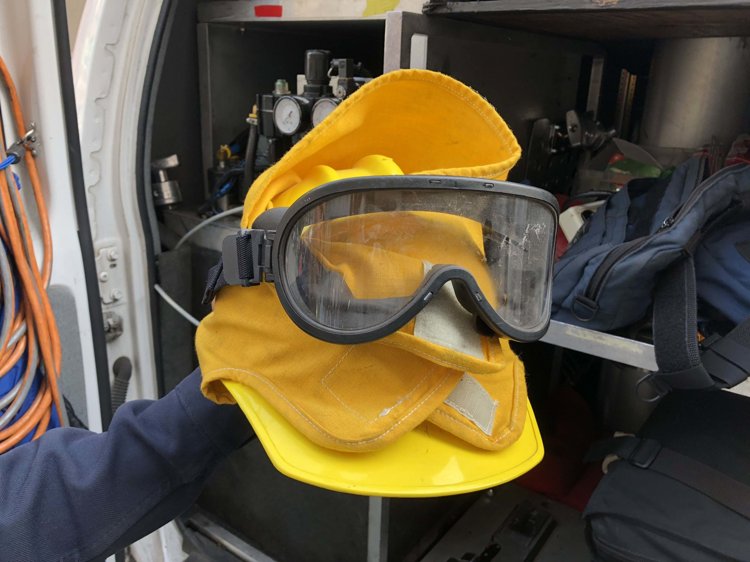 Fire helmet and goggles. In the summer, fires are big news.