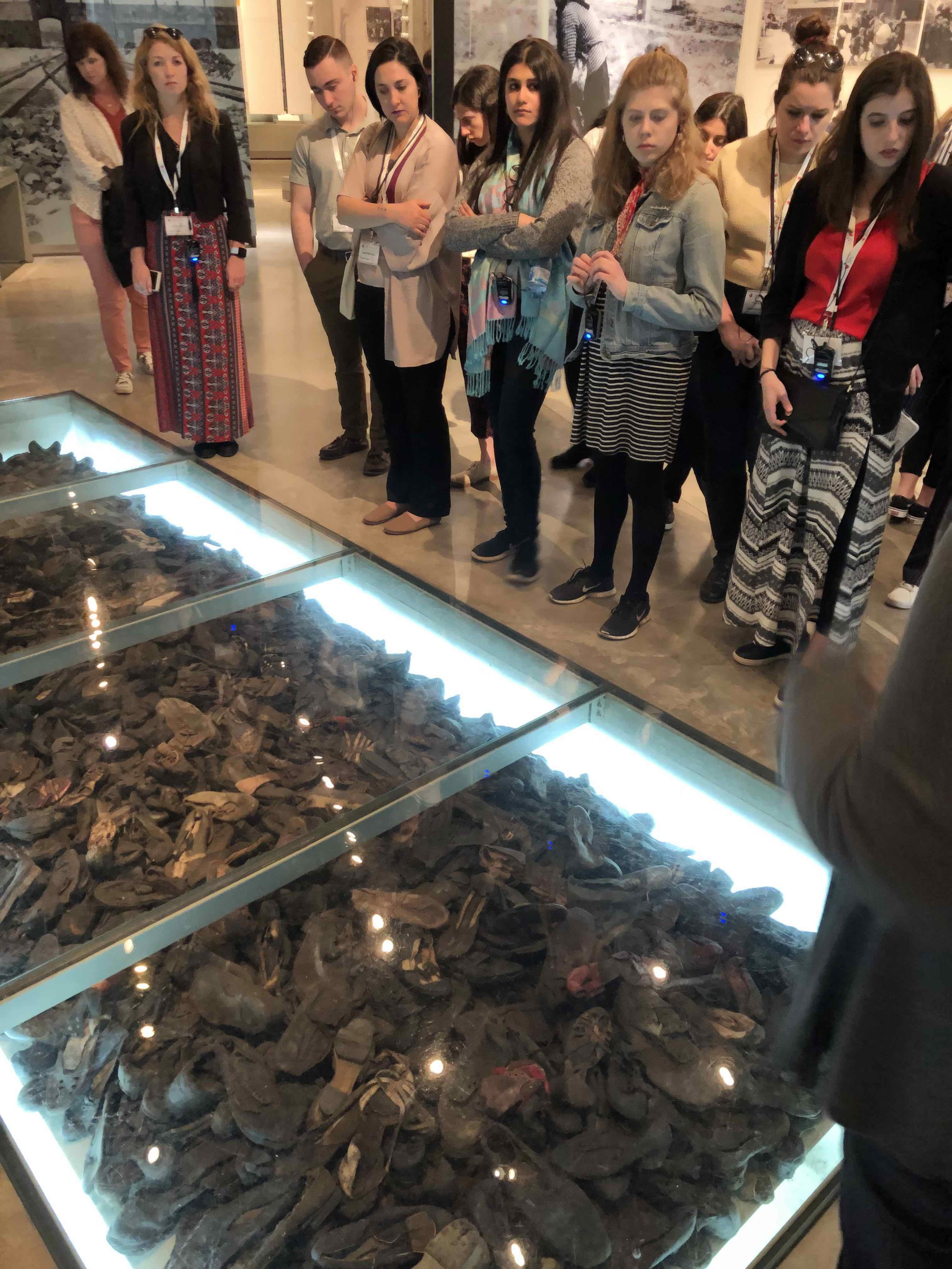 Students absorb the display of shoes collected from Holocaust victims.