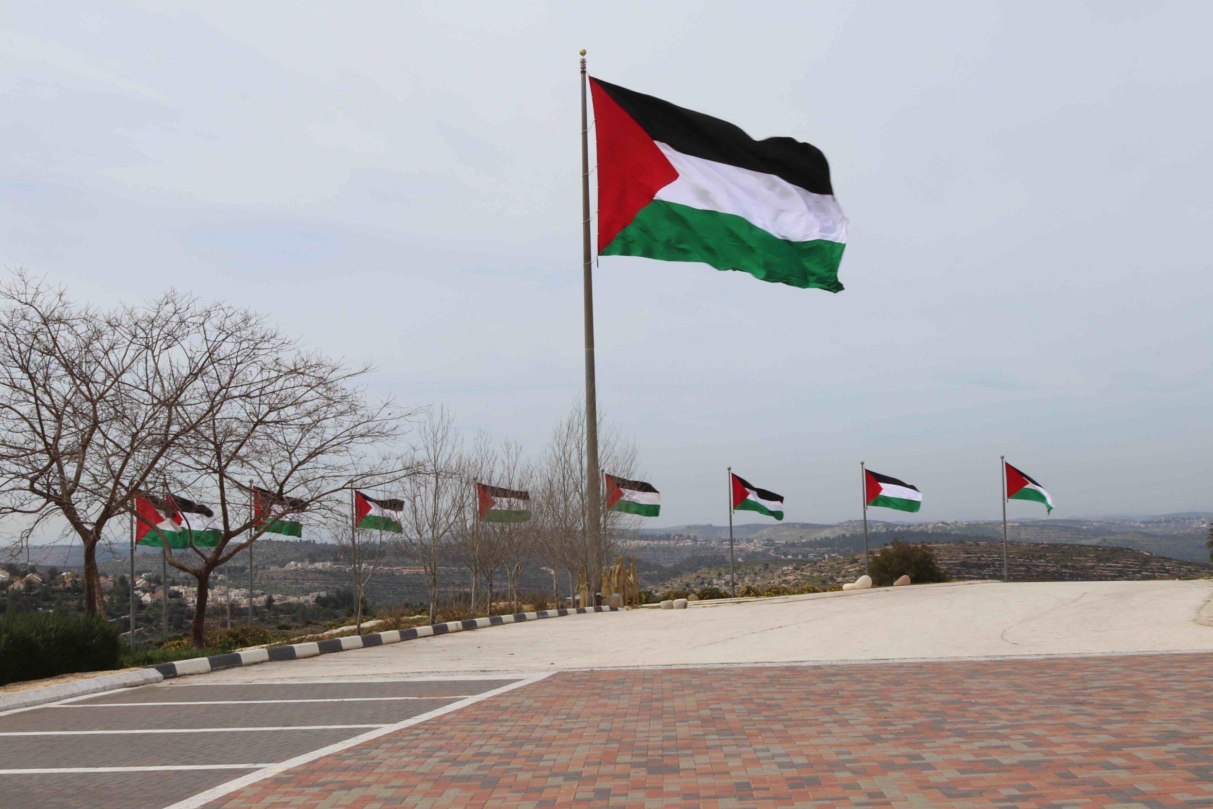 Palestinian flags fly atop Rawabi.