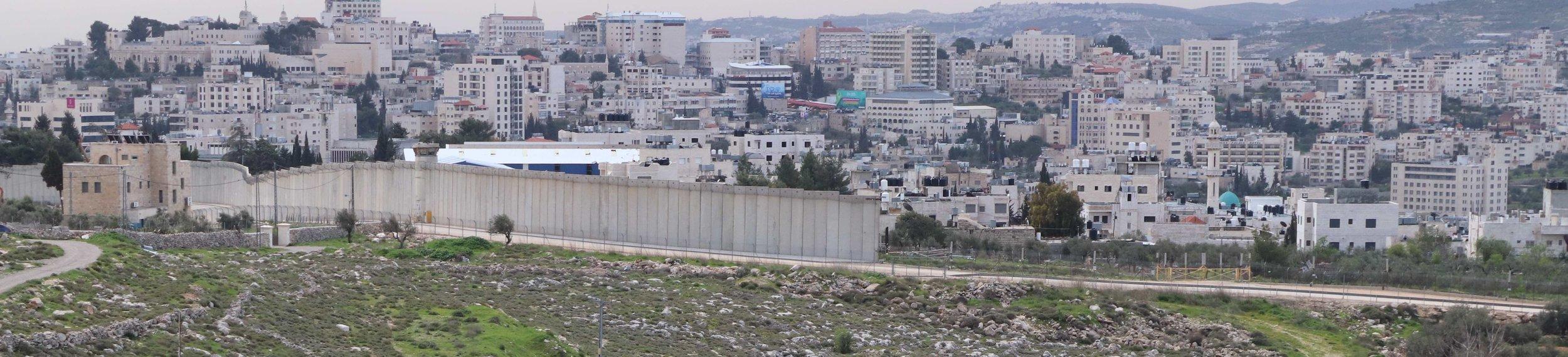 Barrier wall seen looking south from Jerusalem towards Bethlehem