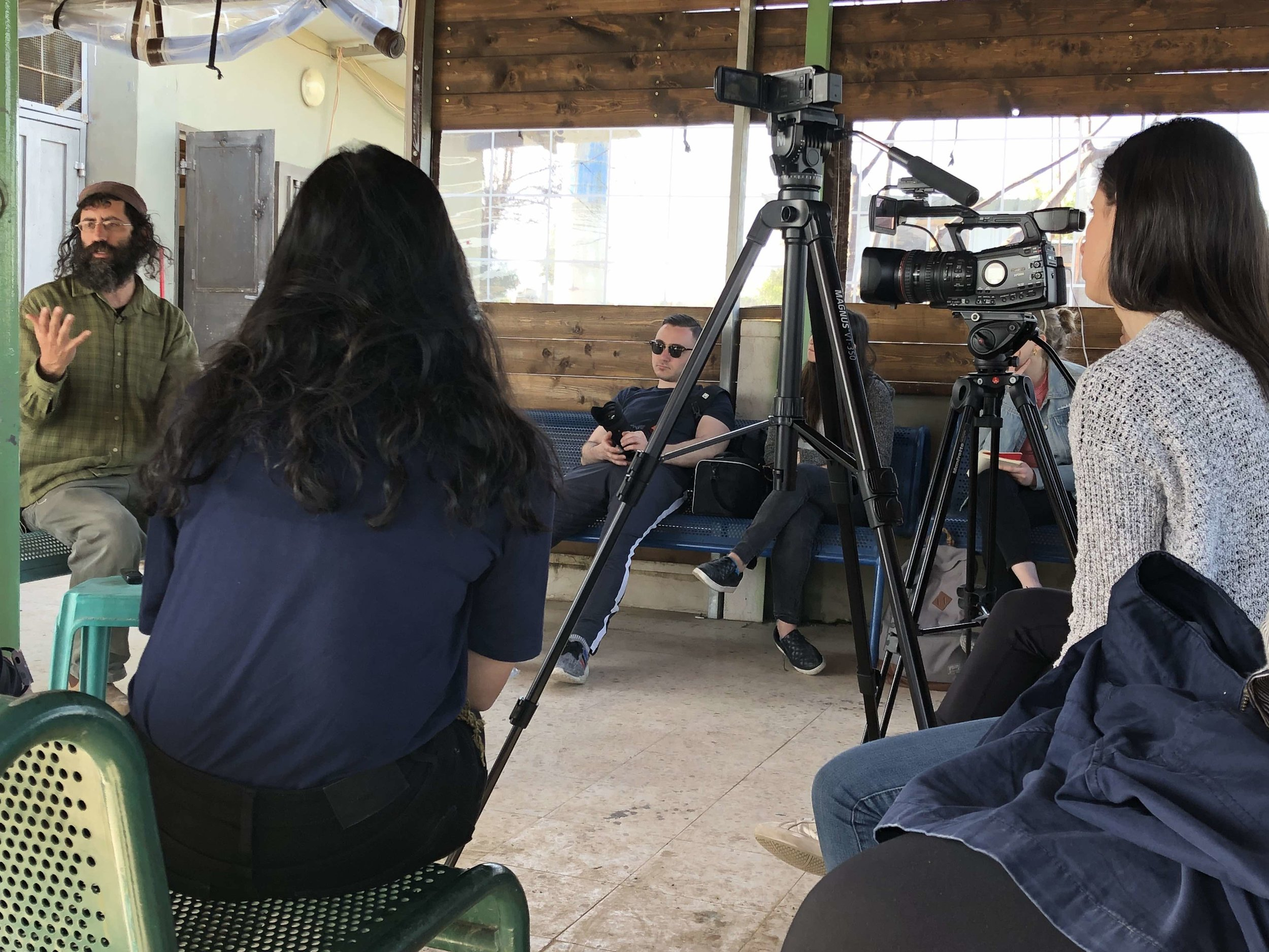 Newhouse students interview Shaul Judelman, left, at Roots, a group that promotes peace in Israel.