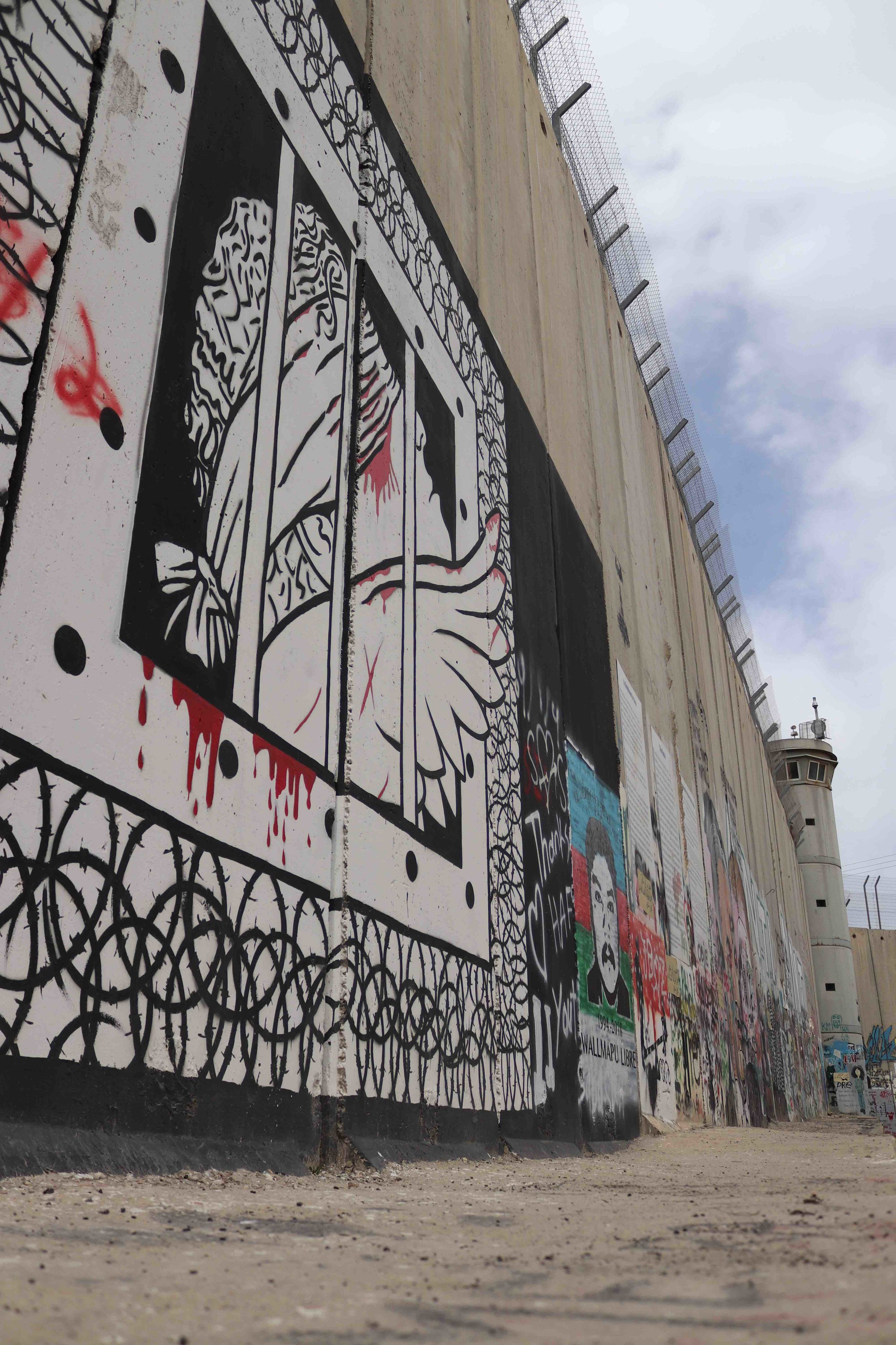 A long view of the graffiti on the wall separating Bethlehem from Jeruslem.