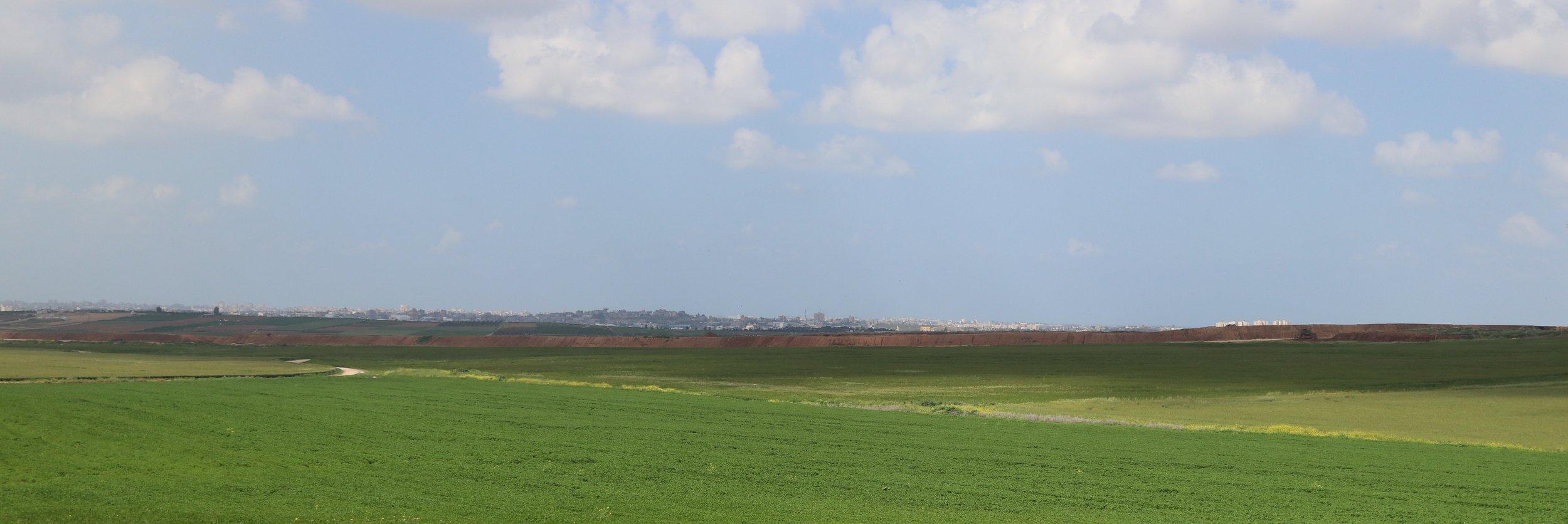 Looking across the open farmland from Israel toward Gaza.