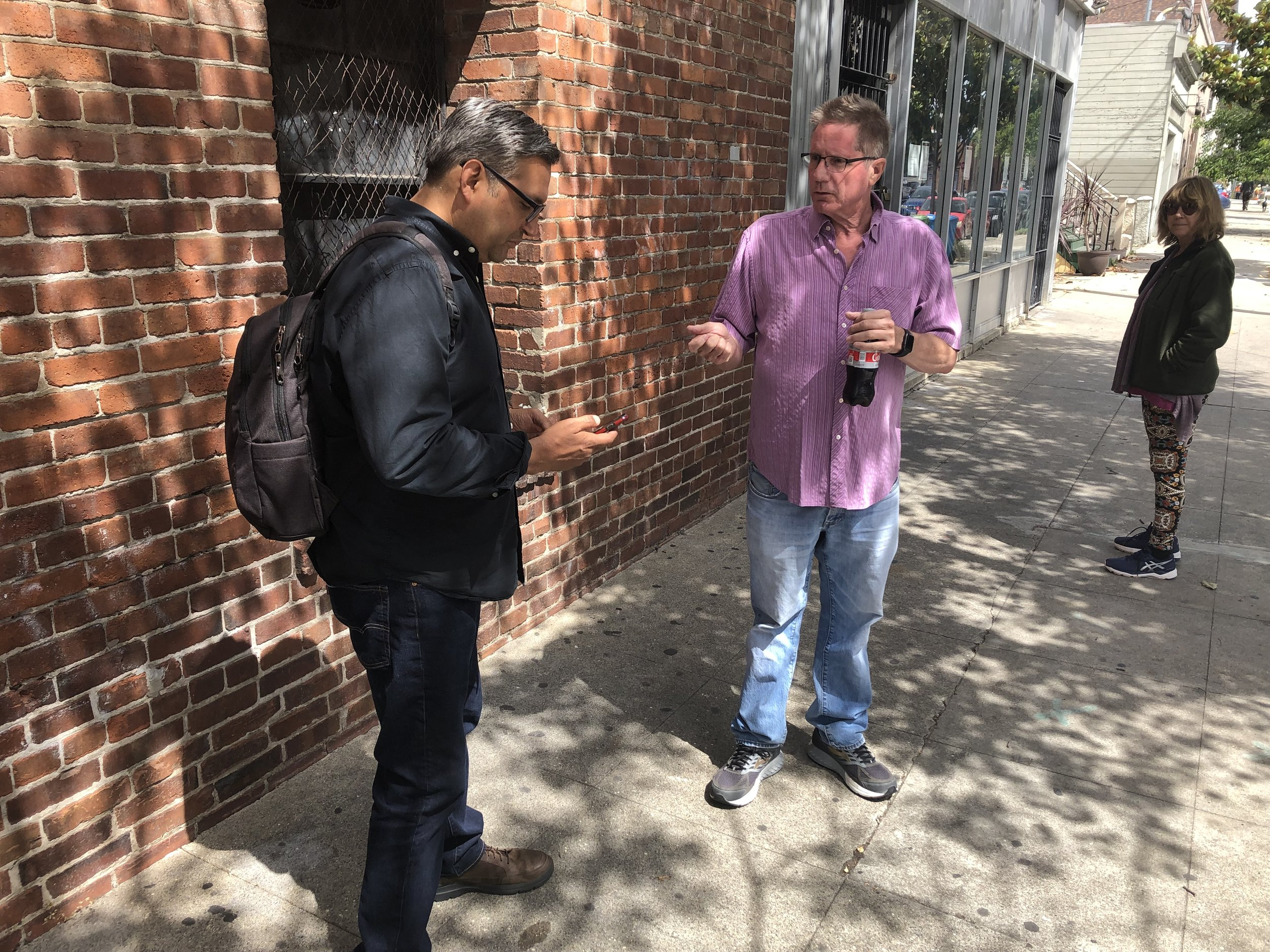 KPIX reporter Joe Vazquez, left, sharing his contact information with a source.