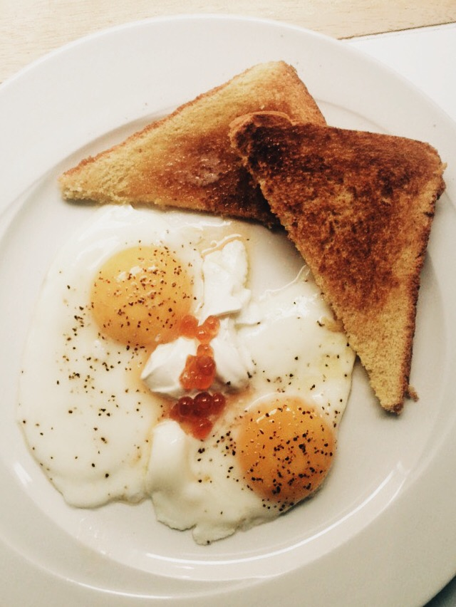 Breakfast on Thanksgiving morning. Eggs over easy and toast, with caviar and creme fraiche.