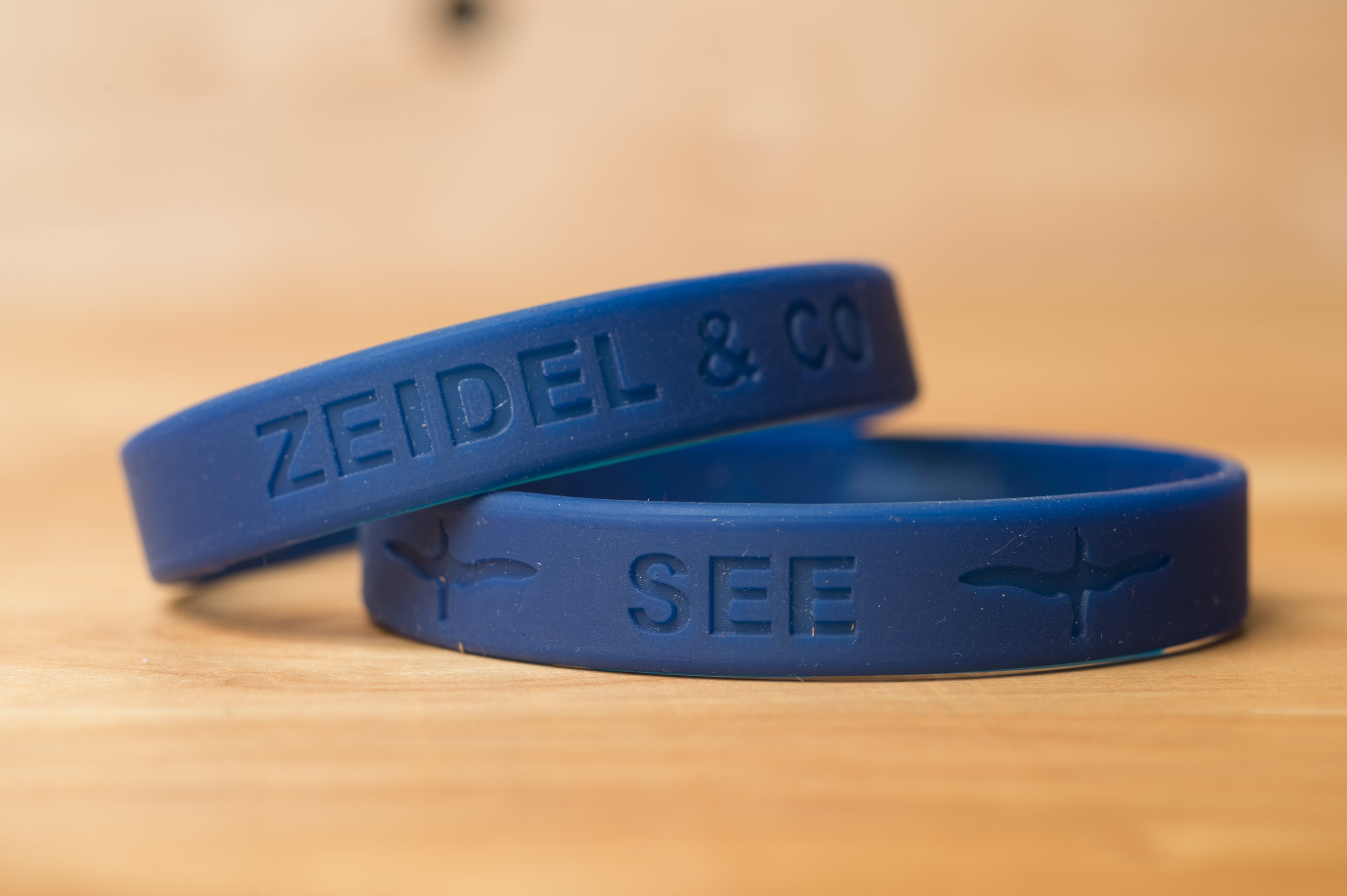 The SEE Alby rubber wristband is the perfect way to showcase your support. $5