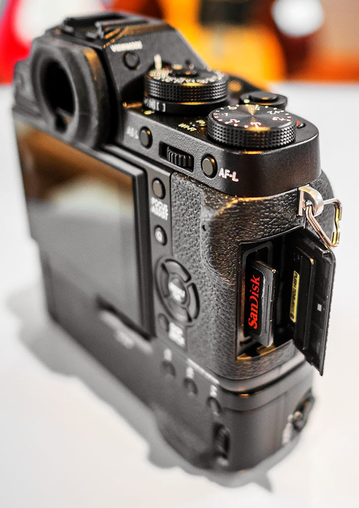 Fuji X-T1 showing SD card compartment.