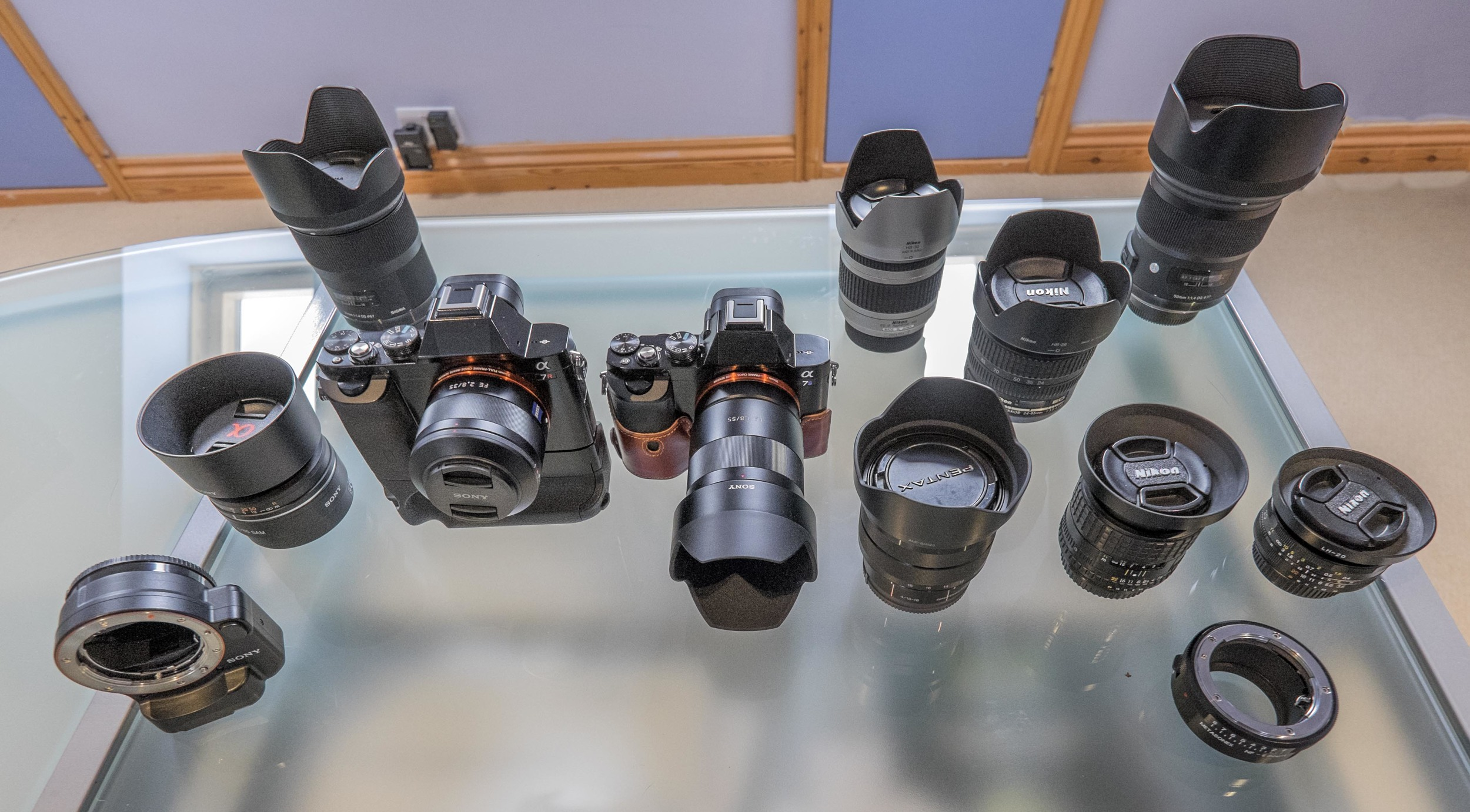 My current Sony FE system. Sony A7r and A7s, Sony FE 55mm F1.8 ZA Carl Zeiss Sonnar T* Lens, Sony FE 35mm f2.8 ZA Carl Zeiss Sonnar T* Lens, Sony VG-C1EM Battery Grip, Sony LA-EA4 adapter, Sony 85mm f/2.8 SAM lens, Sigma 35mm f/1.4 ART lens, Sony E10-18mm f4 OSS Lens, Sigma 50mm f/1.4 ART lens, Nikon 28-200mm f/3.5-5.6 G Zoom Lens, Nikon 24-85mm f/3.5-4.5AF-S G lens , Voigtlander 20mm f3.5 Color Skopar SL II Lens - Nikon Fit, Nikon Series E 100mm f/2.8. Metabones Nikon F > Sony e-mount adapter.