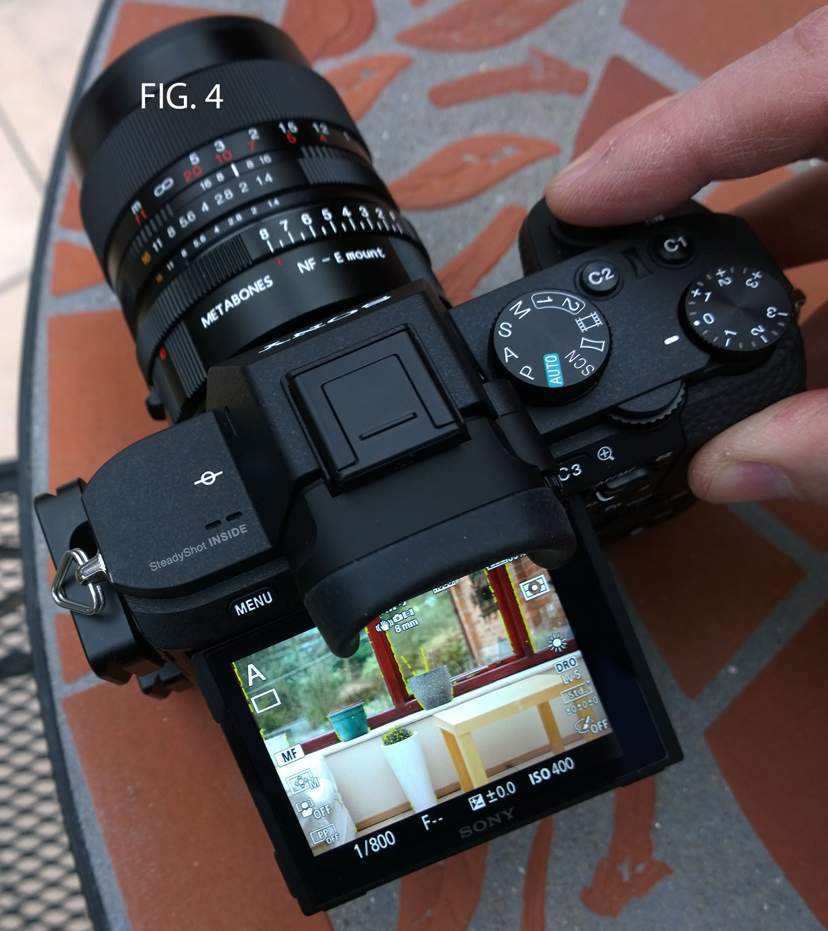 FIG. 4 - Just lightly touching the shutter button returns the screen / EVF to full size and I take the picture.