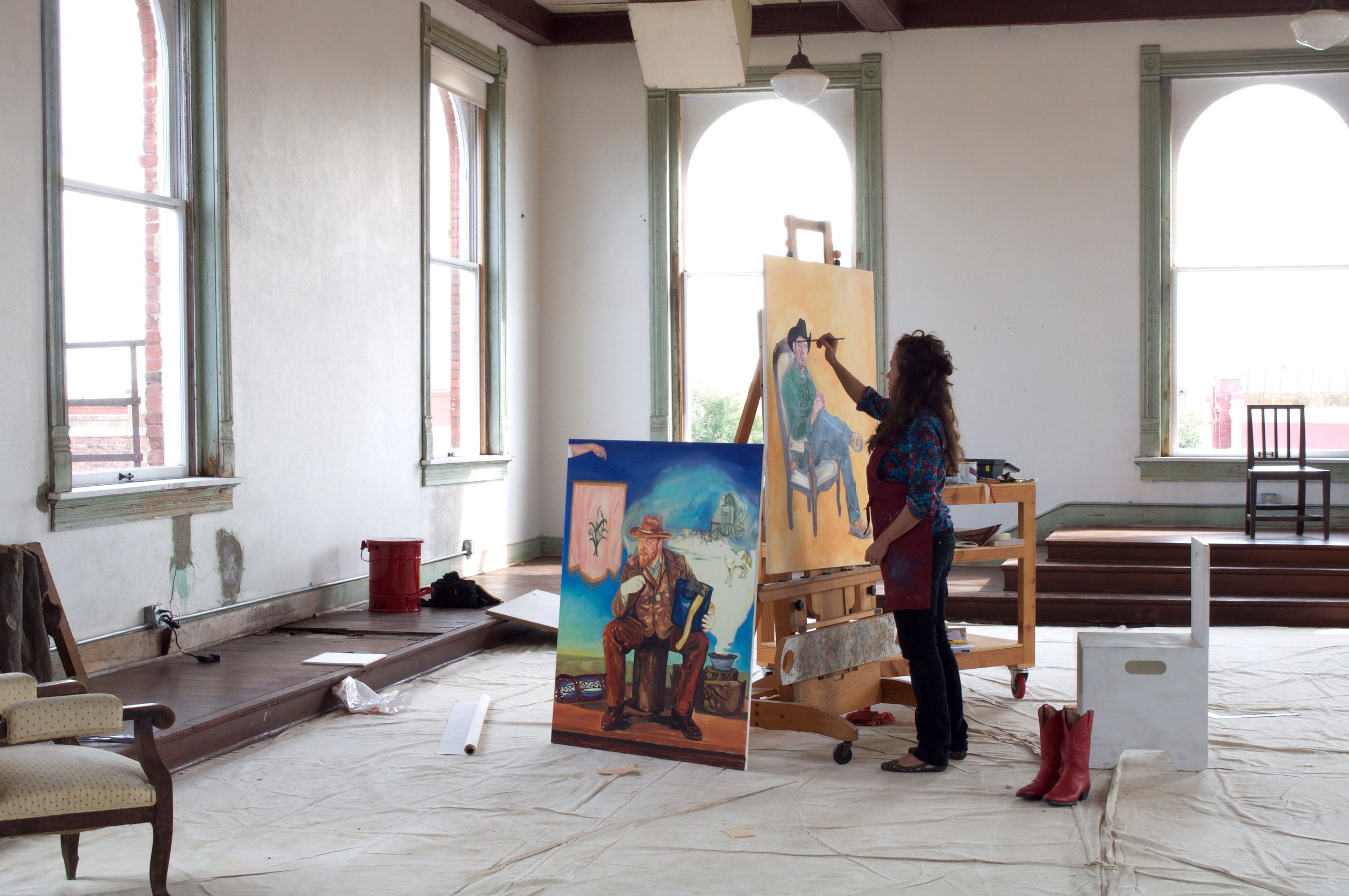 Resident Christina Hayes paints portraits of Corsicana cowboys, in comparison to the Australian concept of the cowboy.