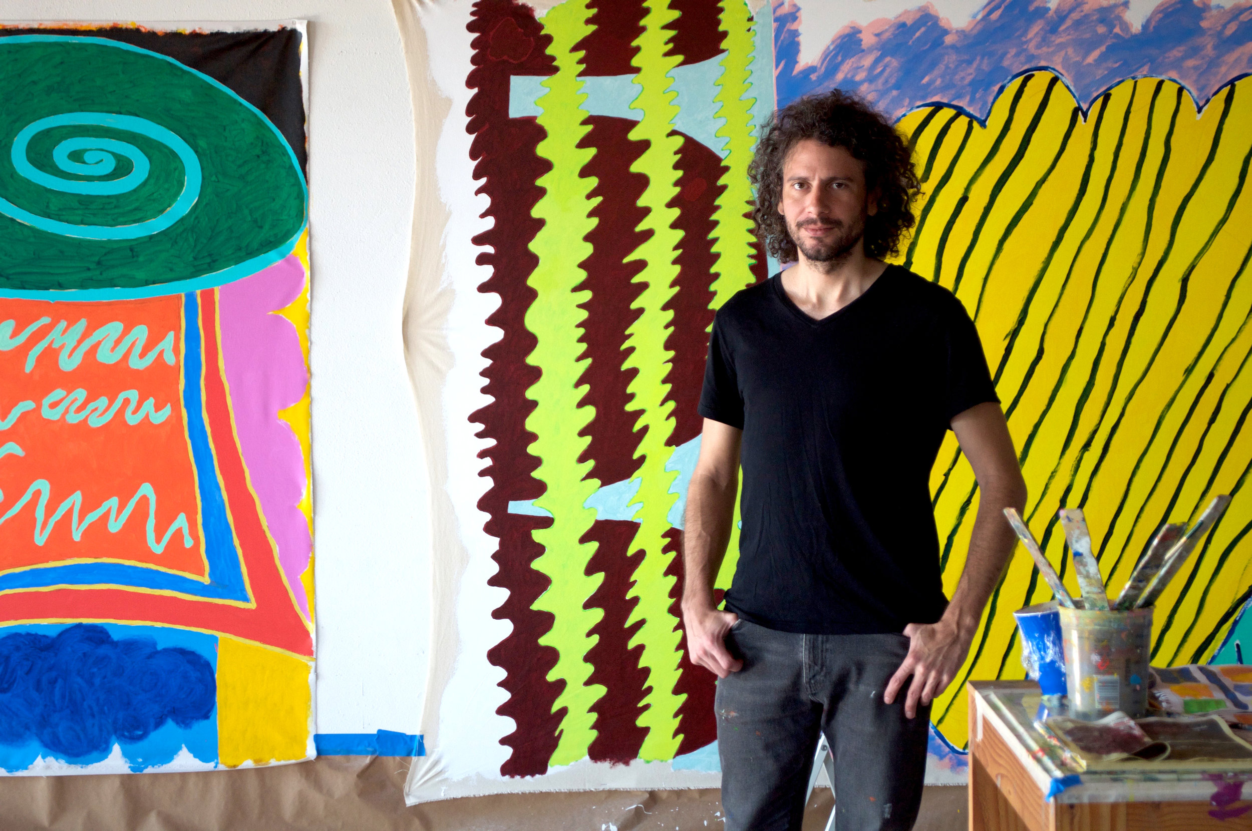 Ryan Thayer Davis in front of works in progress, 2nd Floor
