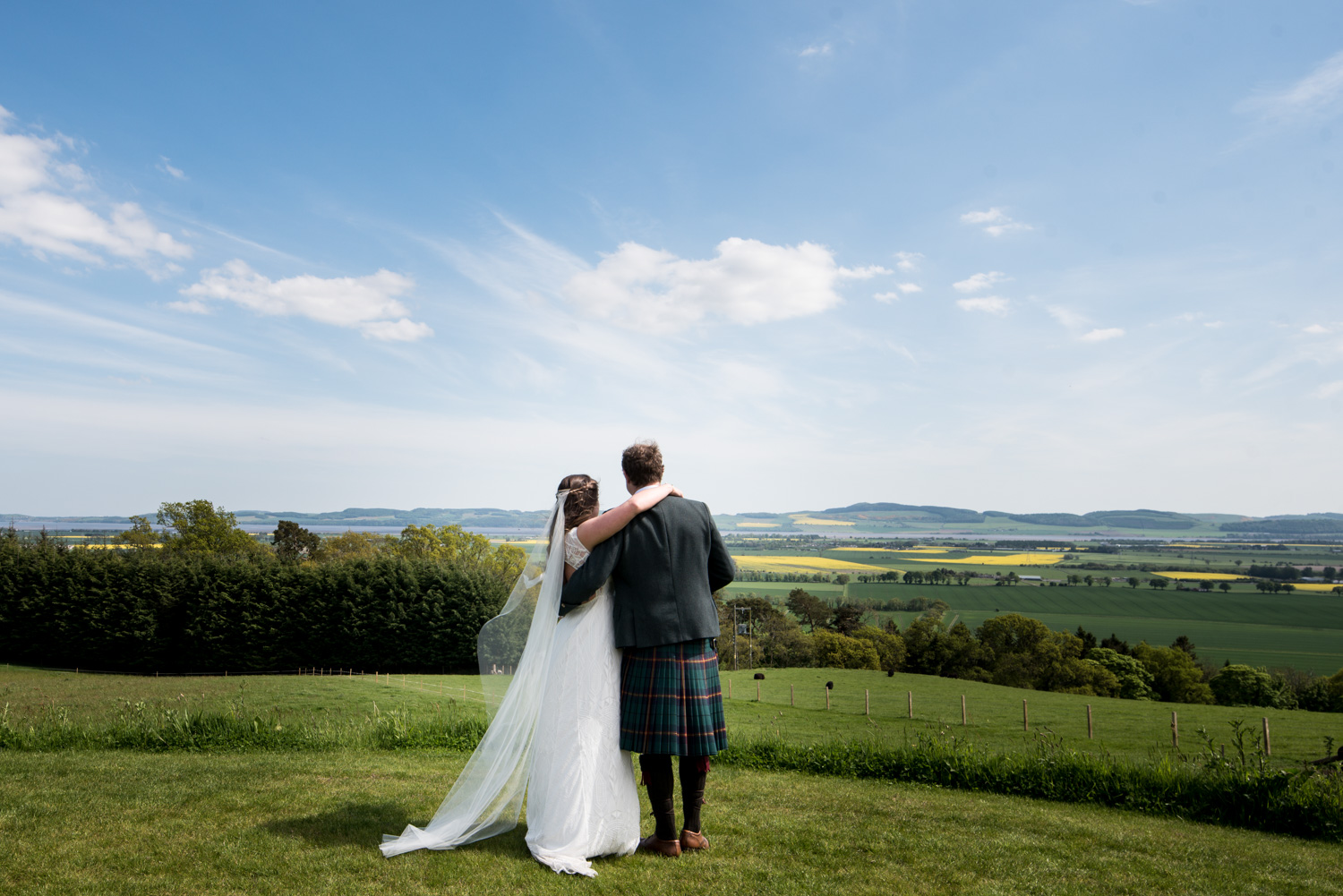 Guardswell Farm - bride and groom admiring the view