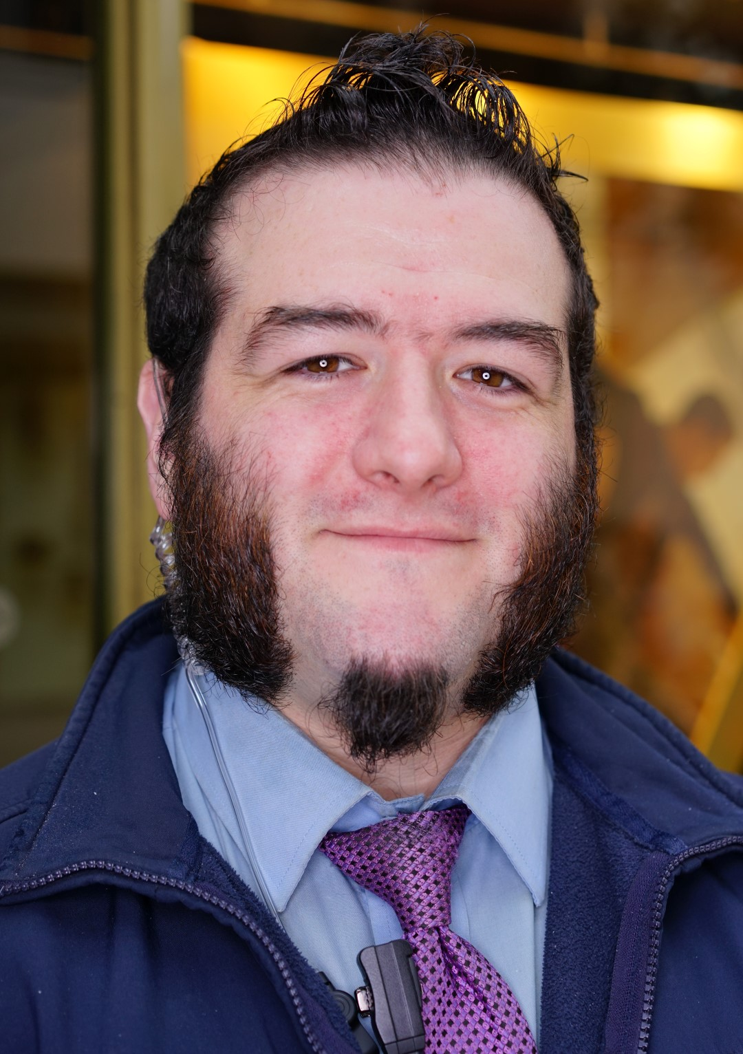 A Security Guard with cool mutton chops, at a dance event in Belfast