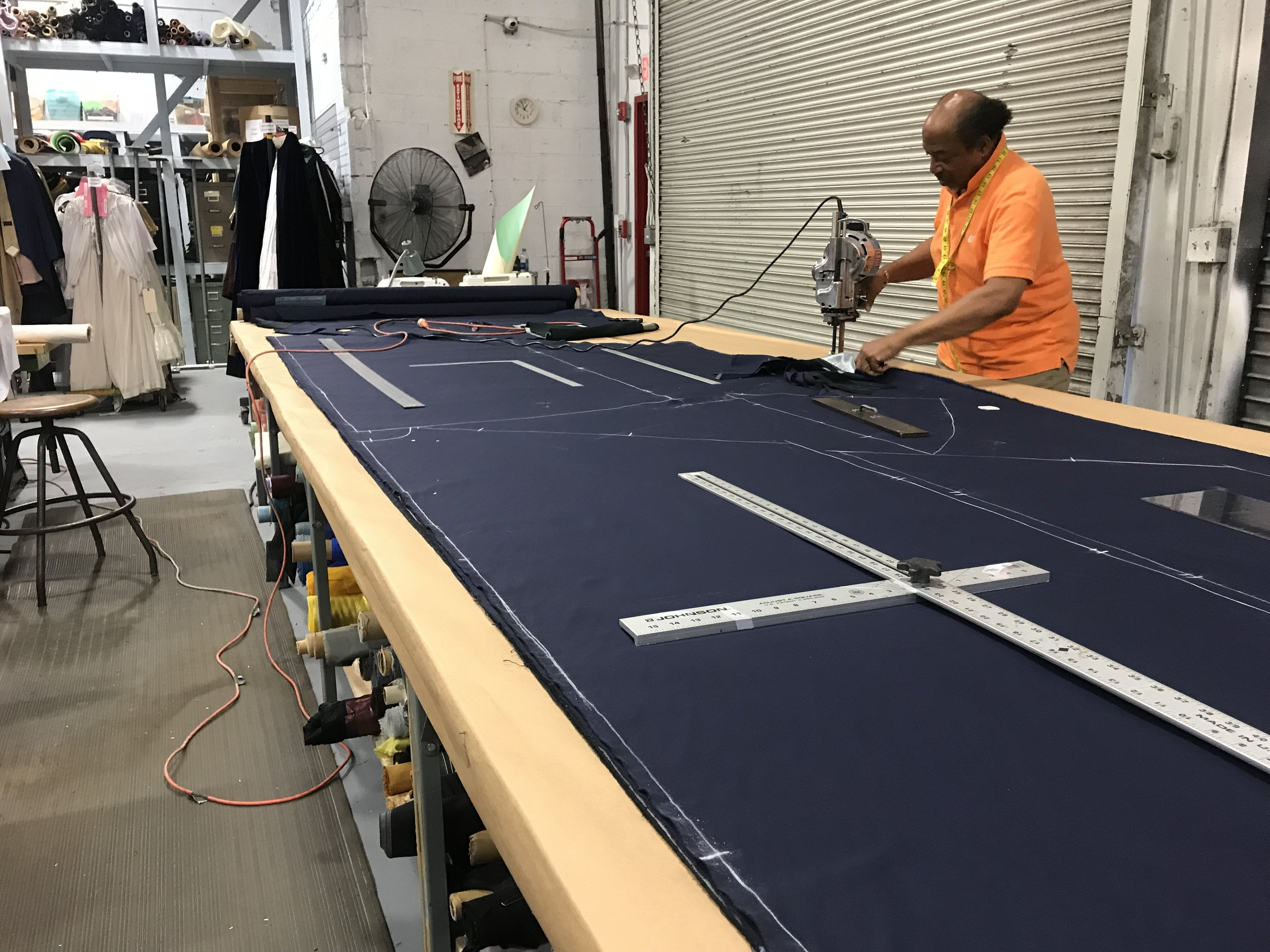 Above is Robert who built the capes, he patterned, chalked and cut the pieces that were in both capes, rolled out all 4 fabrics (outer & lining). Most of the time was spent in the prep, aka measure twice cut once.