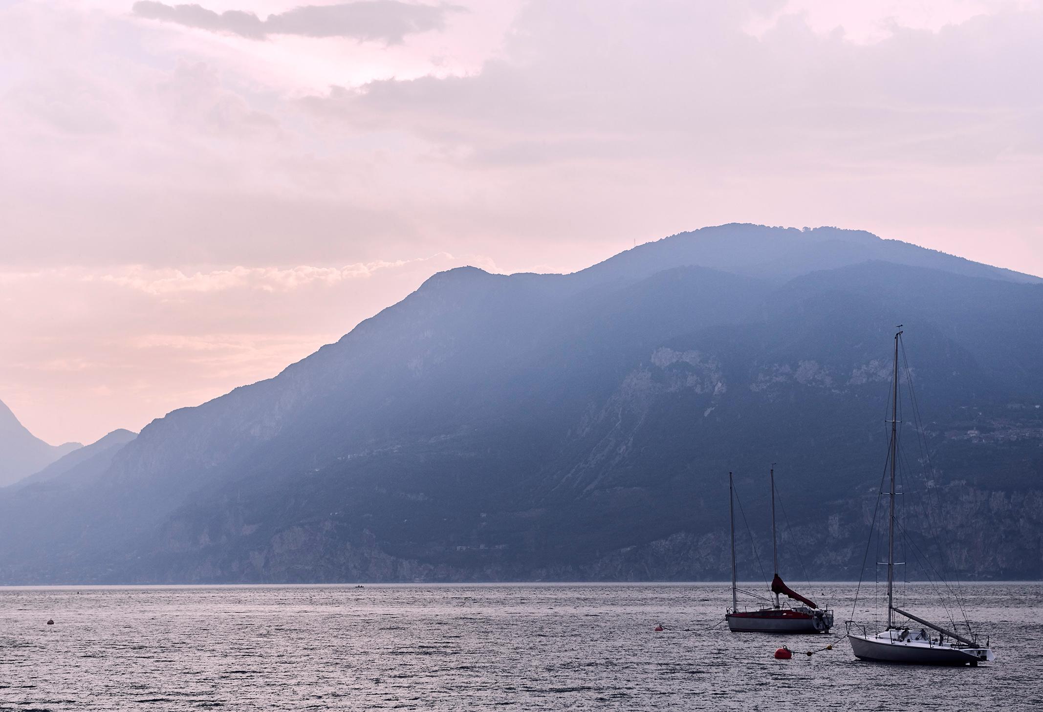 Boats at sunset on Lake Garda, Italy. Kirsty Owen photography