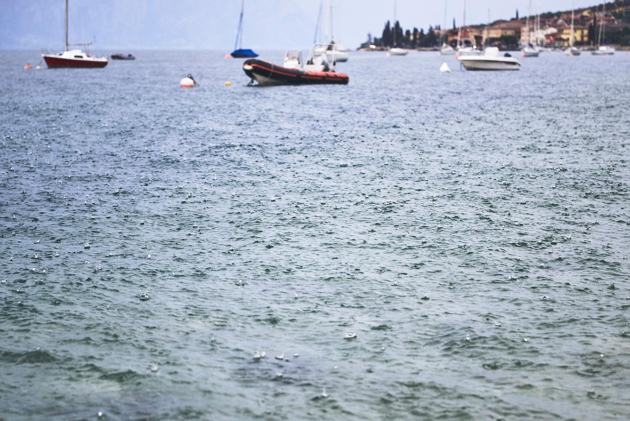 Boats in a rain storm on lake Garda, Italy. Kirsty Owen photography
