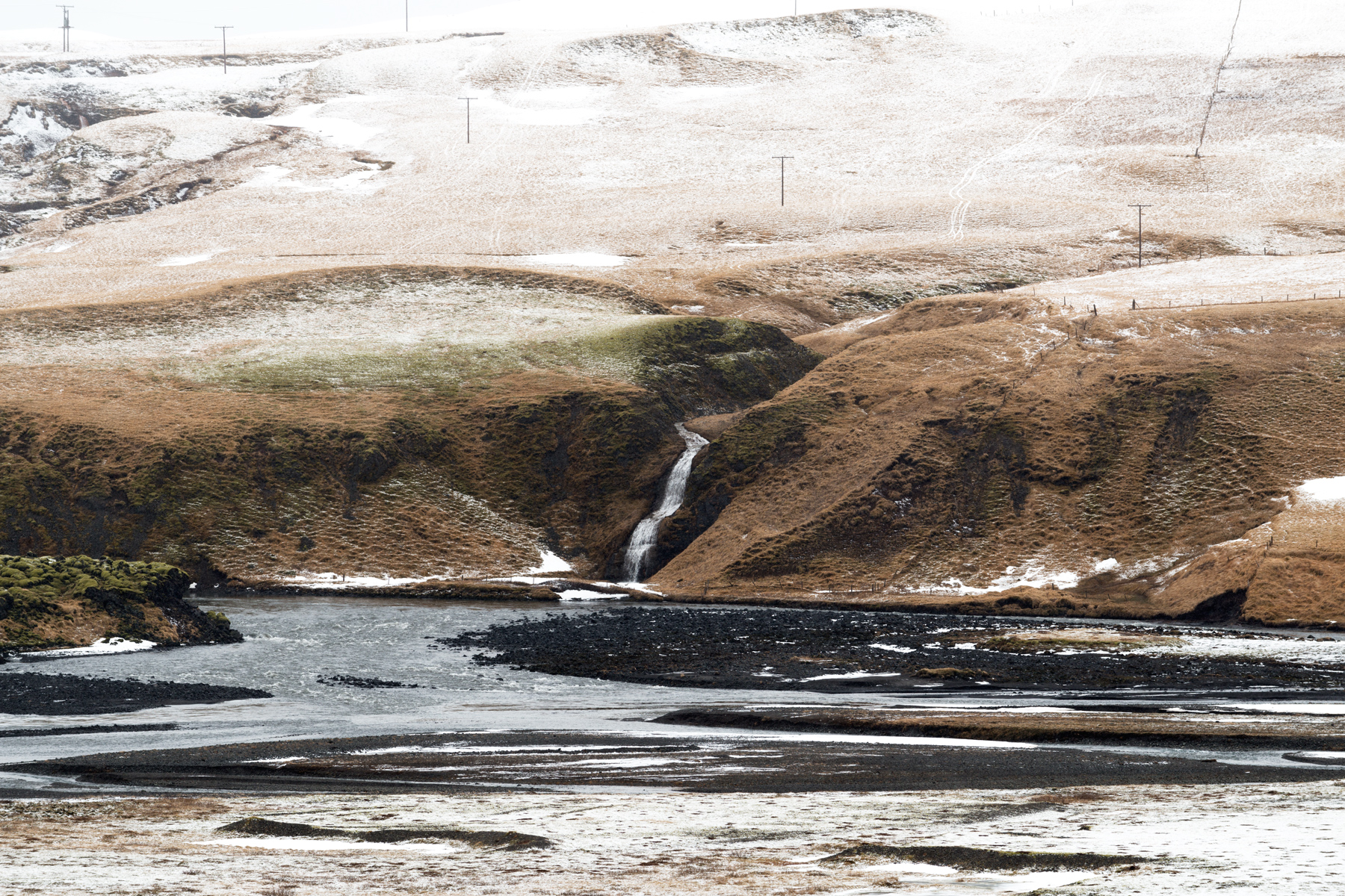 Iceland lanscape with snow and waterfall. Kirsty Owen photography.